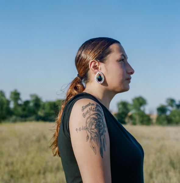 Heather Belgrade, 23, shows a tattoo of her grandmother, who she believes protects her.