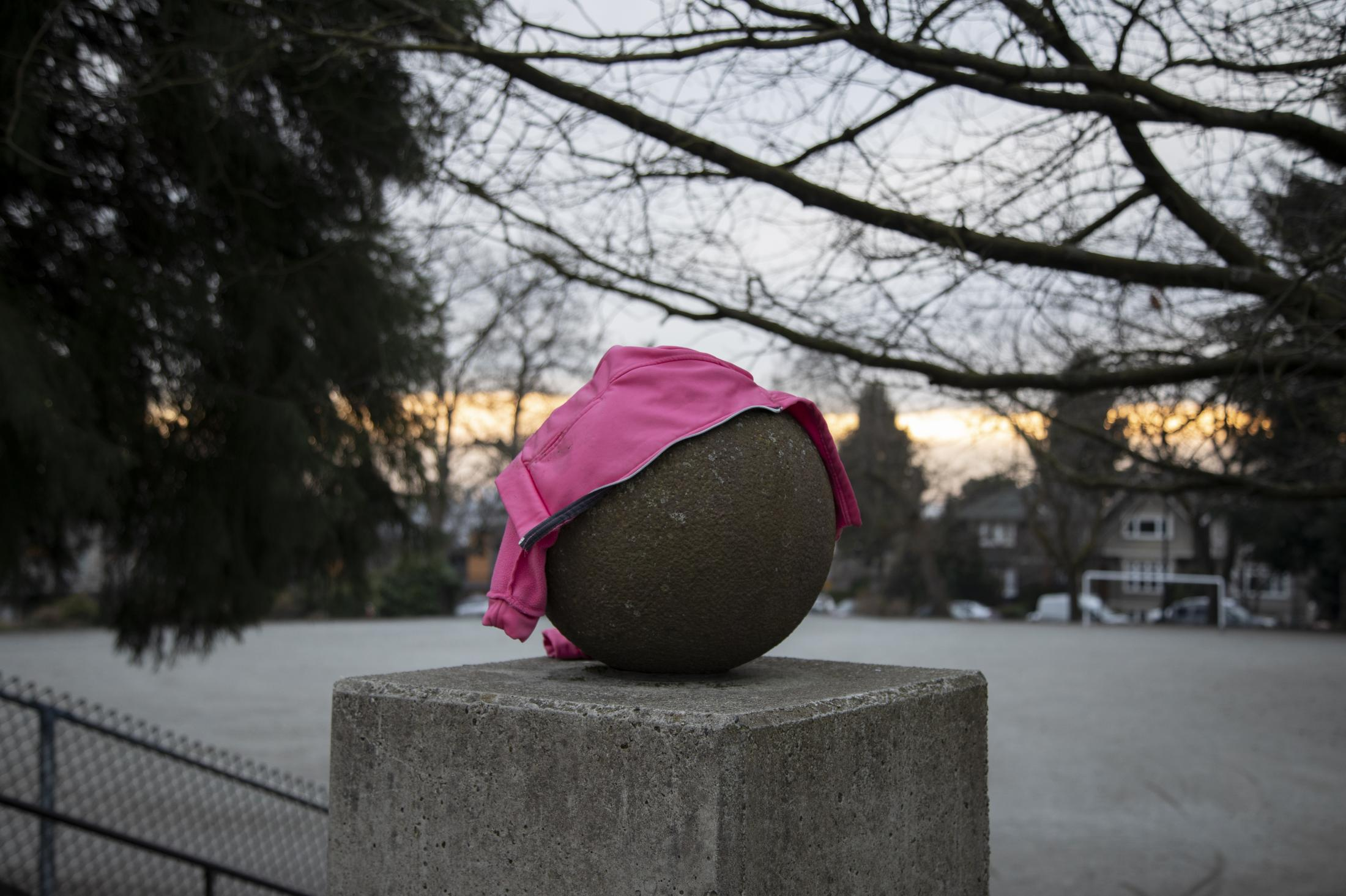 A sweater is seen at a playground at Ridgeway Elementary in North Vancouver, B.C., on Sunday, March 22, 2020. Effective Friday, March 20, 2020, the City and District of North Vancouver have closed all playgrounds and playing fields in an attempt to curb the spread of COVID-19. North Vancouver has been a hotspot of COVID-19, with ten deaths connected to the Lynn Valley Care Centre as of Monday, March 23, 2020.