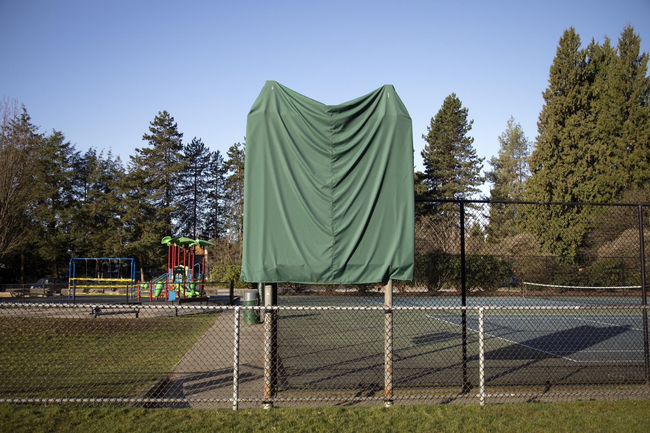 A playing field scoreboard is covered at Eldon Park in North Vancouver, B.C., on Saturday, March 21, 2020. Effective Friday, March 20, 2020, the City and District of North Vancouver have closed all playgrounds and playing fields in an attempt to curb the spread of COVID-19. North Vancouver has been a hotspot of COVID-19, with ten deaths connected to the Lynn Valley Care Centre as of Monday, March 23, 2020.