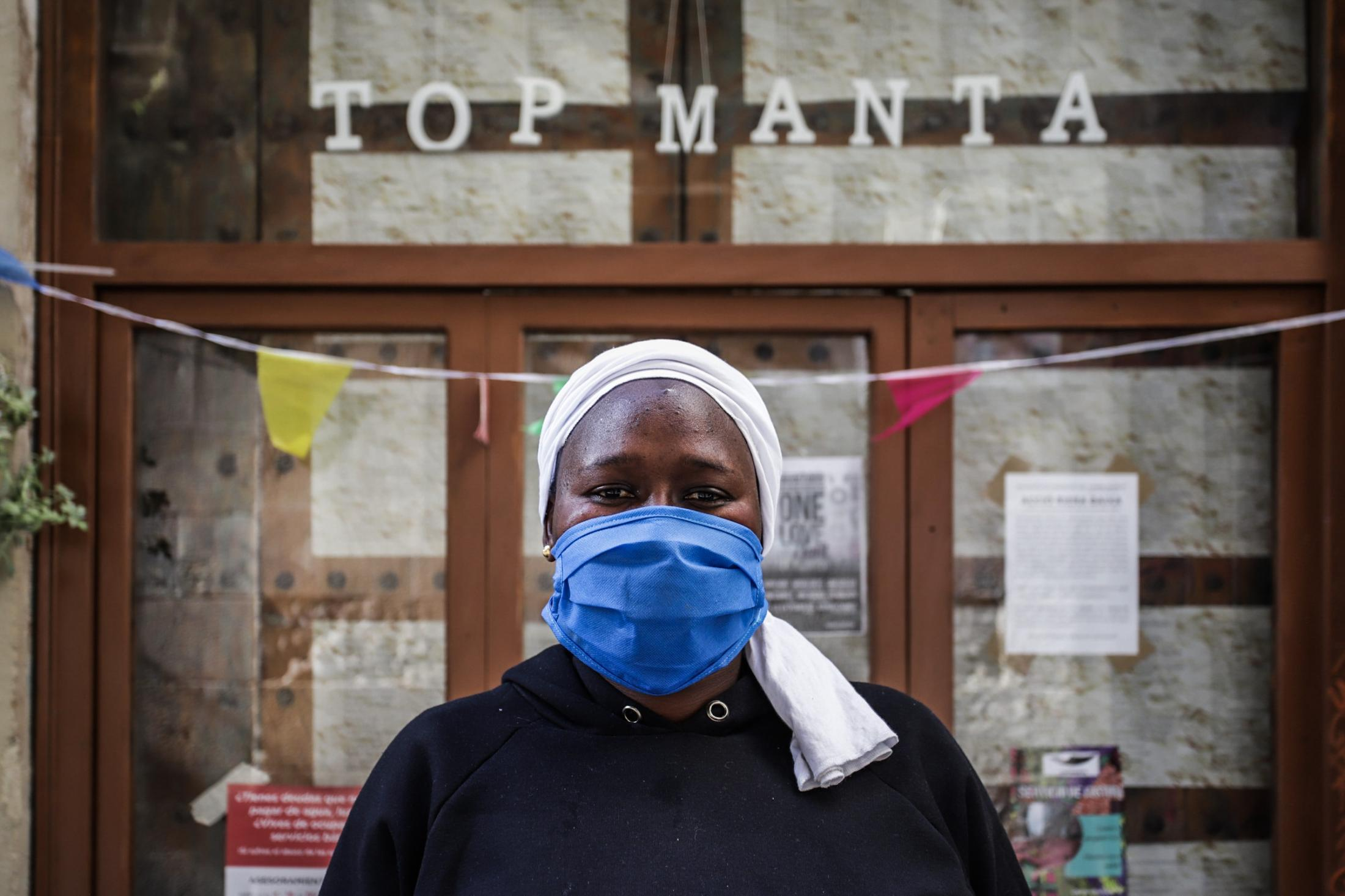 """Buso portrait out of the Top manta store. Faced with the deprivation of rights, this group has responded with solidarity. The members of this union have redirected their production: if they used to make textiles for their brand 'Top Manta', now they make robes and """"thousands of masks"""" that they are already sending to Catalan hospitals. In addition, like unions in other autonomous communities, they collect donations and basic foodstuffs through their Facebook account. They do it to """"help people totally excluded from the labor and social system"""""""