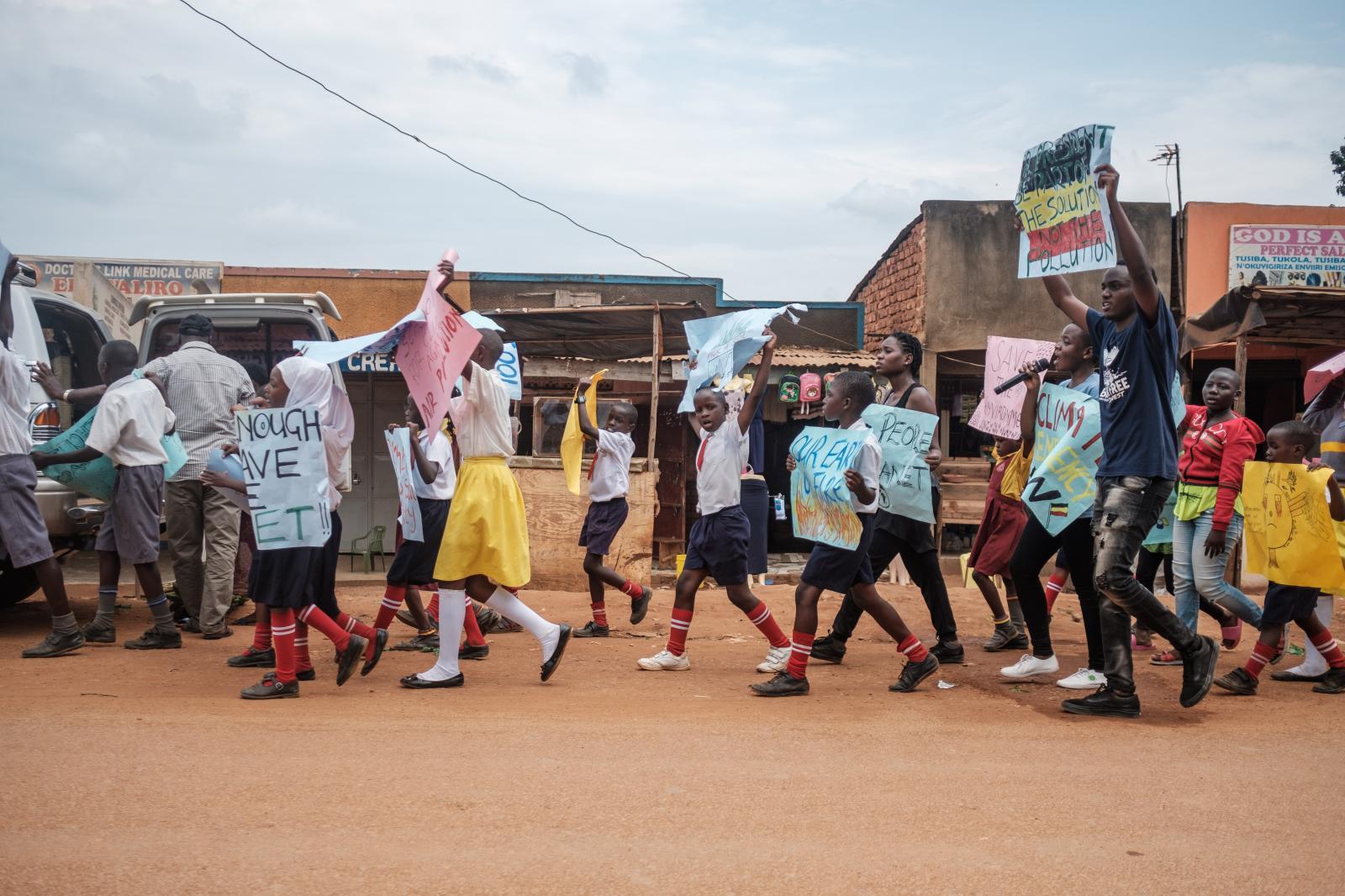 Photography image - Loading NYTCLIMATESTRIKE_Uganda_LeahNamugerwa-27.jpg