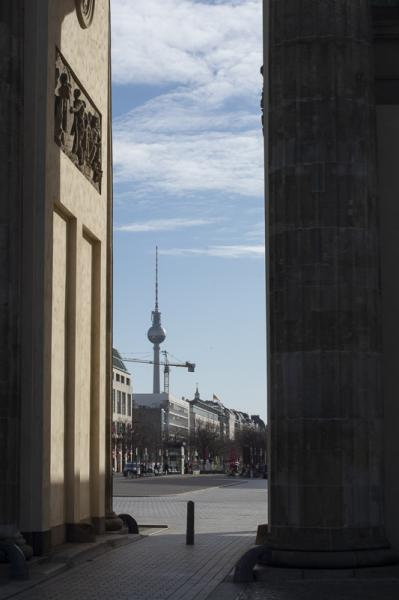 Empty streets looking through the Brandenburg Gate to the TV tower in Berlin, Germany stays in partial lockdown as the Corona Virus continues to claim lives.