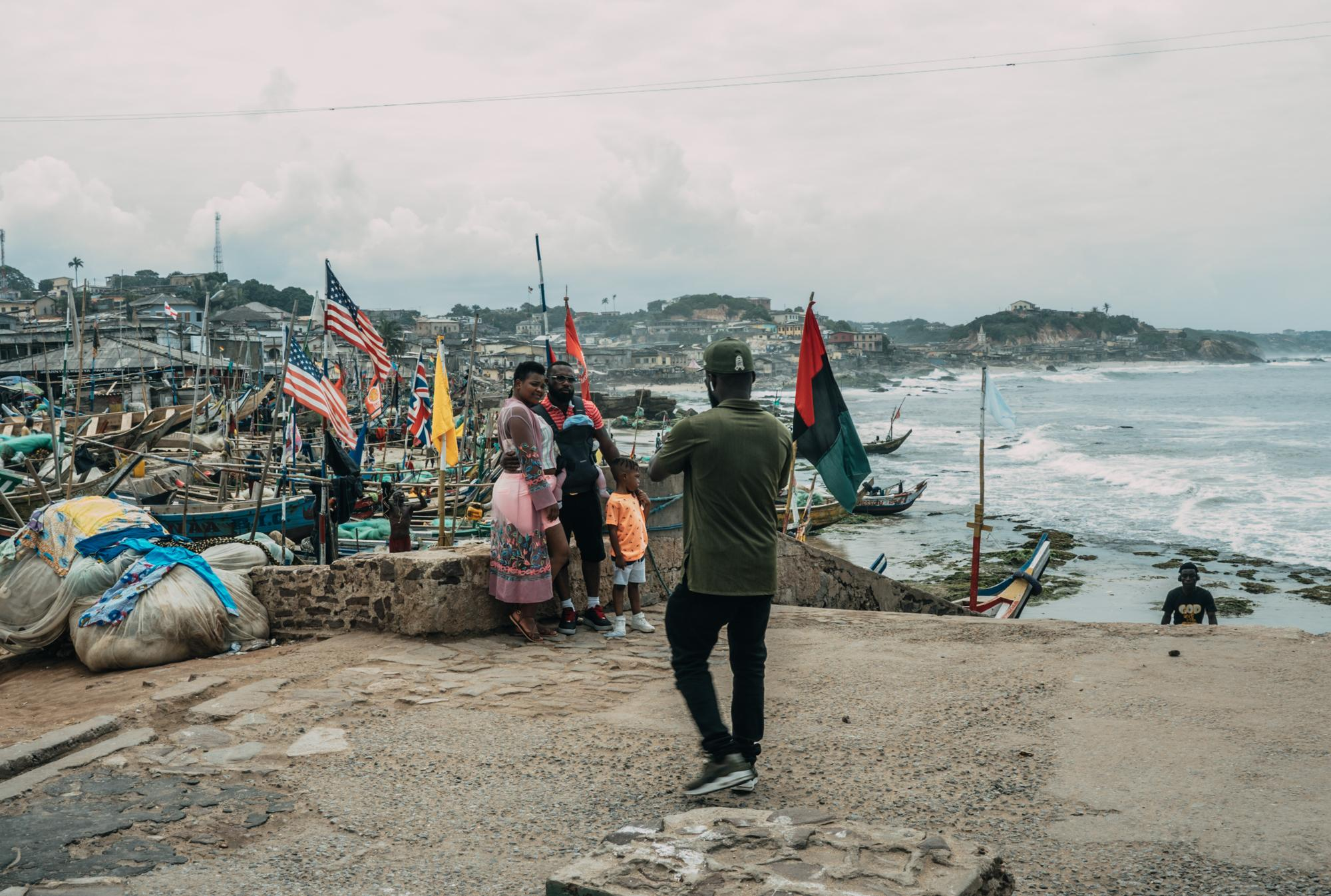 Visitors take pictures with an iconic view outside the Cape Coast Castle
