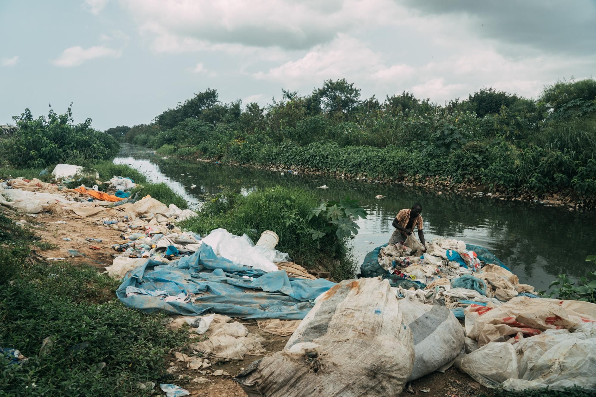 Plastic collector is cleaning and sorting single use plastic bags and bottles recovered from Mallam river. Accra waste collection project was one of 6 winners of the best climate project in the world announced by C40 and Bloomberg Philanthropies at the 2019. Story for AP Bloomberg Philanthropies.