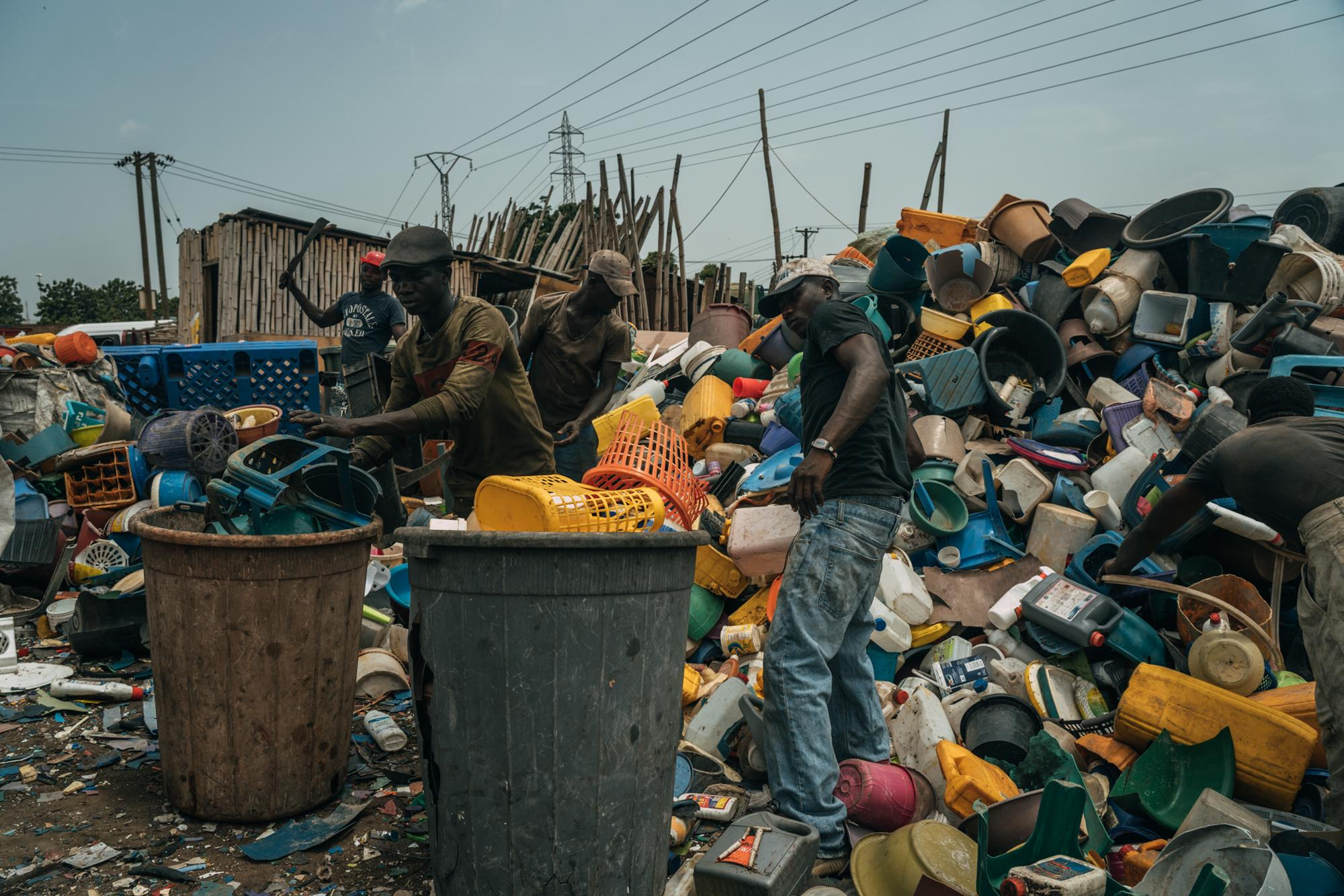 Workers at Accra waste management plant segregating plastic waste. Accra waste collection project was one of 6 winners of the best climate project in the world announced by C40 and Bloomberg Philanthropies at the 2019. Story for AP Bloomberg Philanthropies.