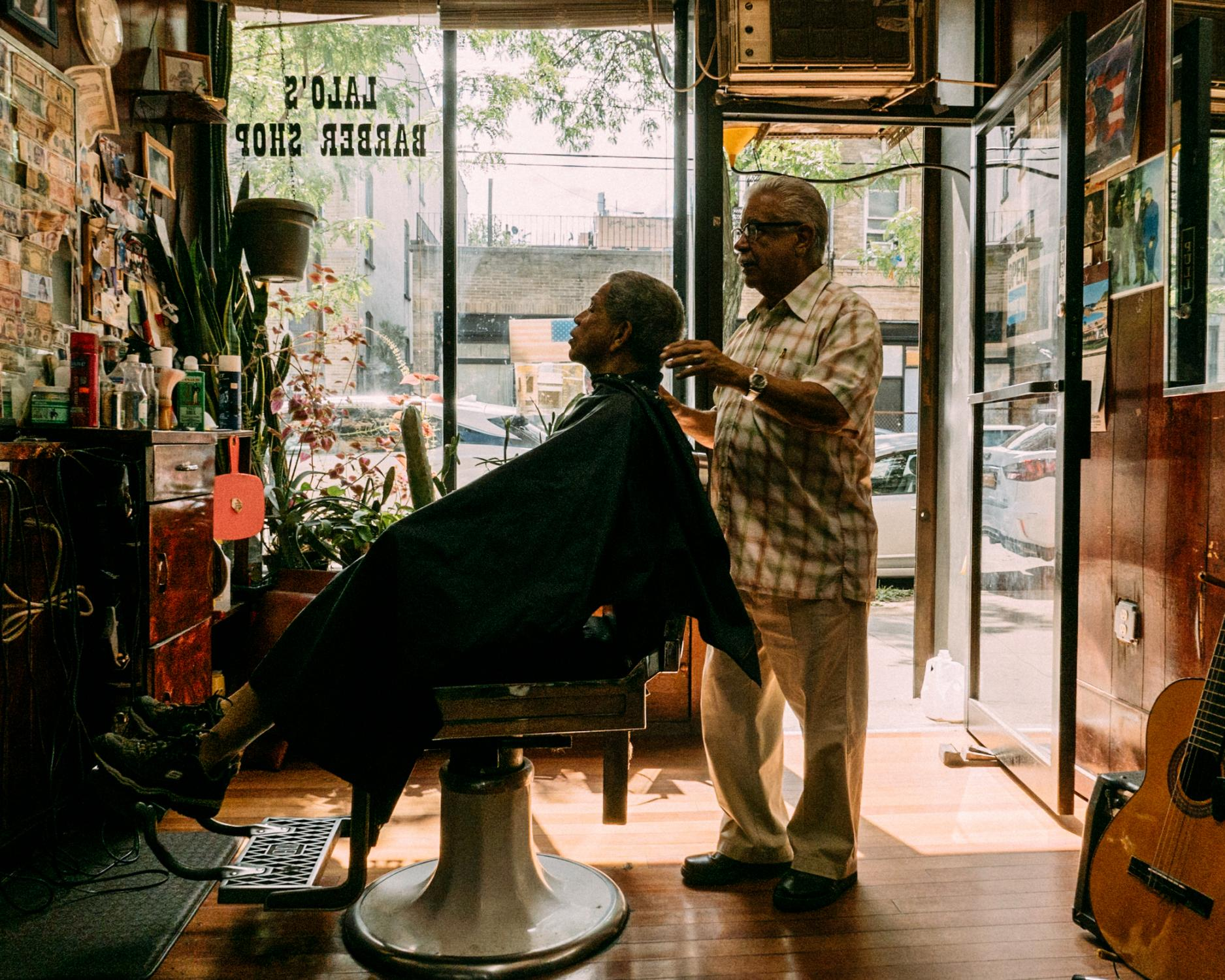 As the warm morning light of the summer begins to peak over the Bushwick skyline, the shop fills up with laughter and stories as Eladio Burgos, 77, cuts the hair of the day's first customer.
