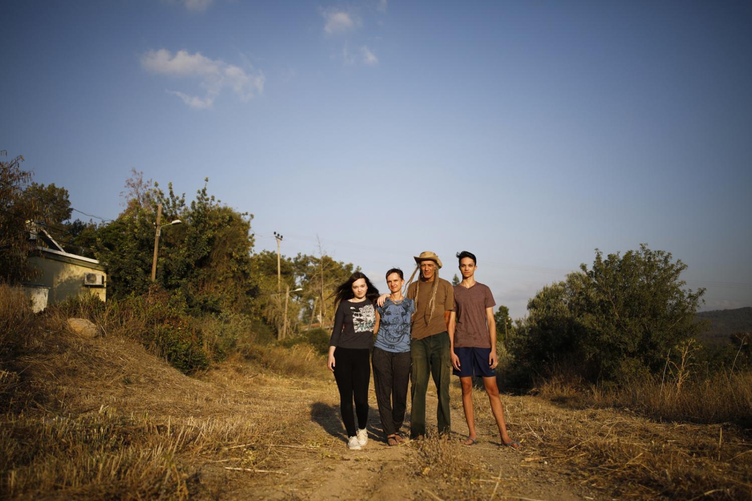 Shenhav,14, Betti Cohen Kowalski, 50, Eitan Cohen, 63, and Yahel, 16, (L-R) pose for portrait in the area where they live, in Kibbutz Harel, Israel, May 30, 2018.