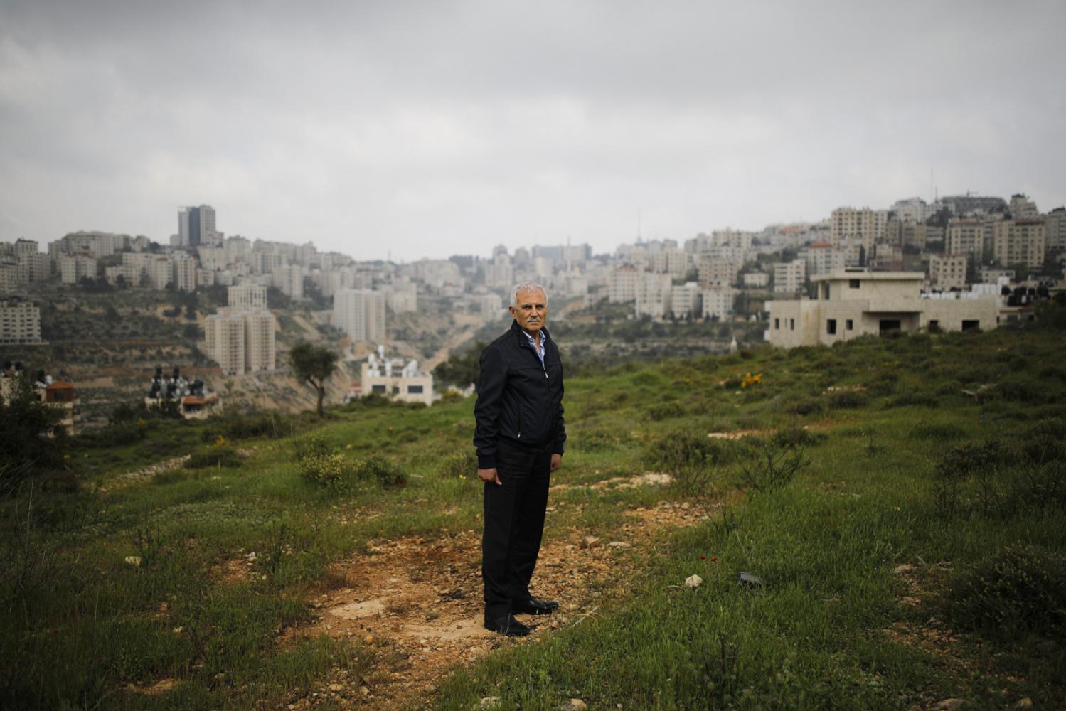 RAMALLAH, WESTBANK - APRIL 14, 2019: Portrait of Palestinian Jamal Zakou, 61, near his home in Ramallah, Westbank. CREDIT: Corinna Kern for The New York Times