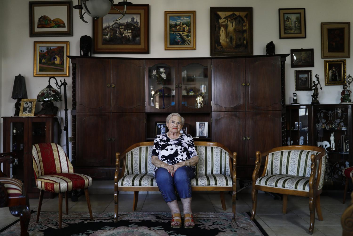 Portrait of Holocaust Survivor Magda Baratz, 90, in her home in Rishon LeTsion, August 11, 2019.