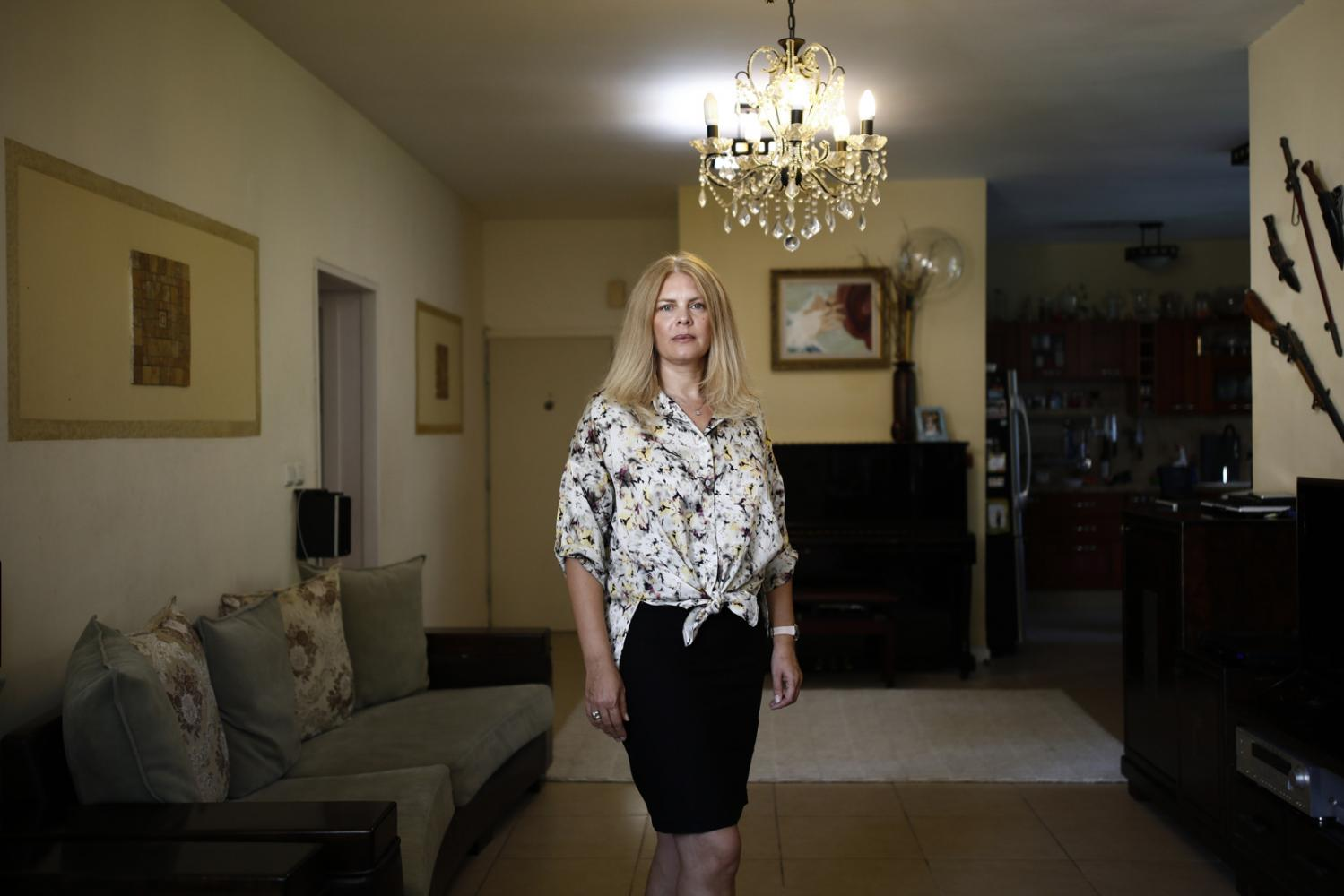 Portrait of Yanna Hodyrker, 46, who immigrated from Ukraine to Israel and was awarded Miss Israel in 1993, in her home in Rehovot, Israel, August 13, 2019.