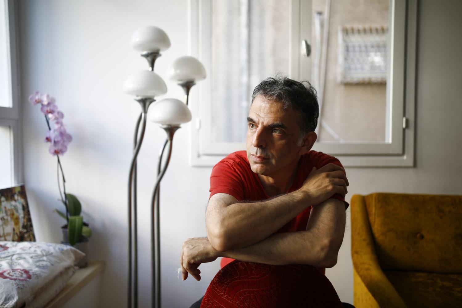 TEL AVIV, ISRAEL - AUGUST 15, 2019: Portrait of Israeli writer Etgar Keret in his home in Tel Aviv, Israel. CREDIT: Corinna Kern for The New York Times