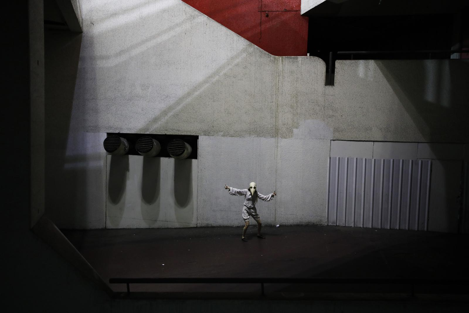 """Dana Forer, 40, an actress and manager of the Mystorin Theatre Ensemble, performs in the group's show """"Seven,"""" a site-specific act that uses all seven floors of the Central Bus Station in Tel Aviv, Israel, May 25, 2019. """"The Central Bus Station is a playground for imagination,"""" Forer said. """"I feel full of joy and creativity when we light up the dark spaces with our performance."""""""