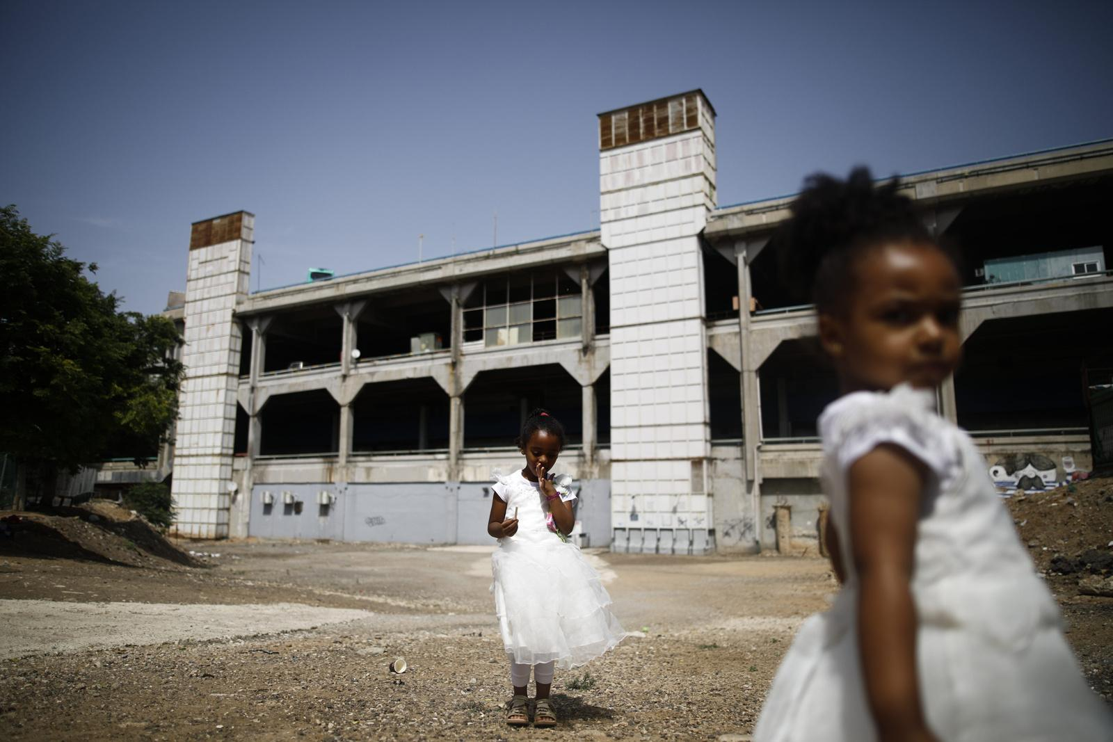 Girls from Eritrea play in an open area opposite the Central Bus Station in Tel Aviv, Israel, May 25, 2019.