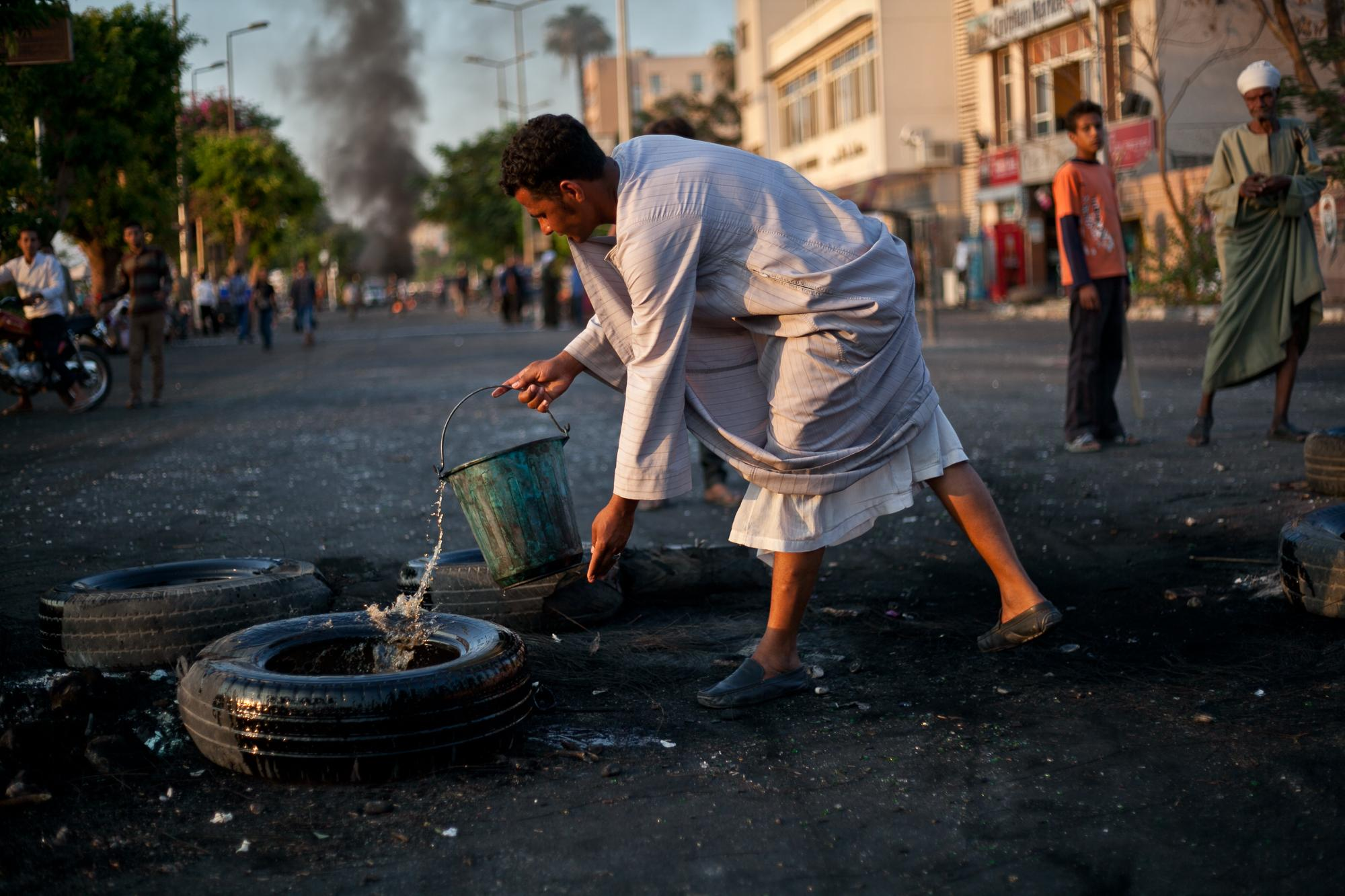 Luxor demonstrators set tires on fire in protest of President Mohamed Morsi's decision to appoint a governor from the Gama'a Islamiyya. The governor resigned but many Luxor residents say they will still protest on June 30th.