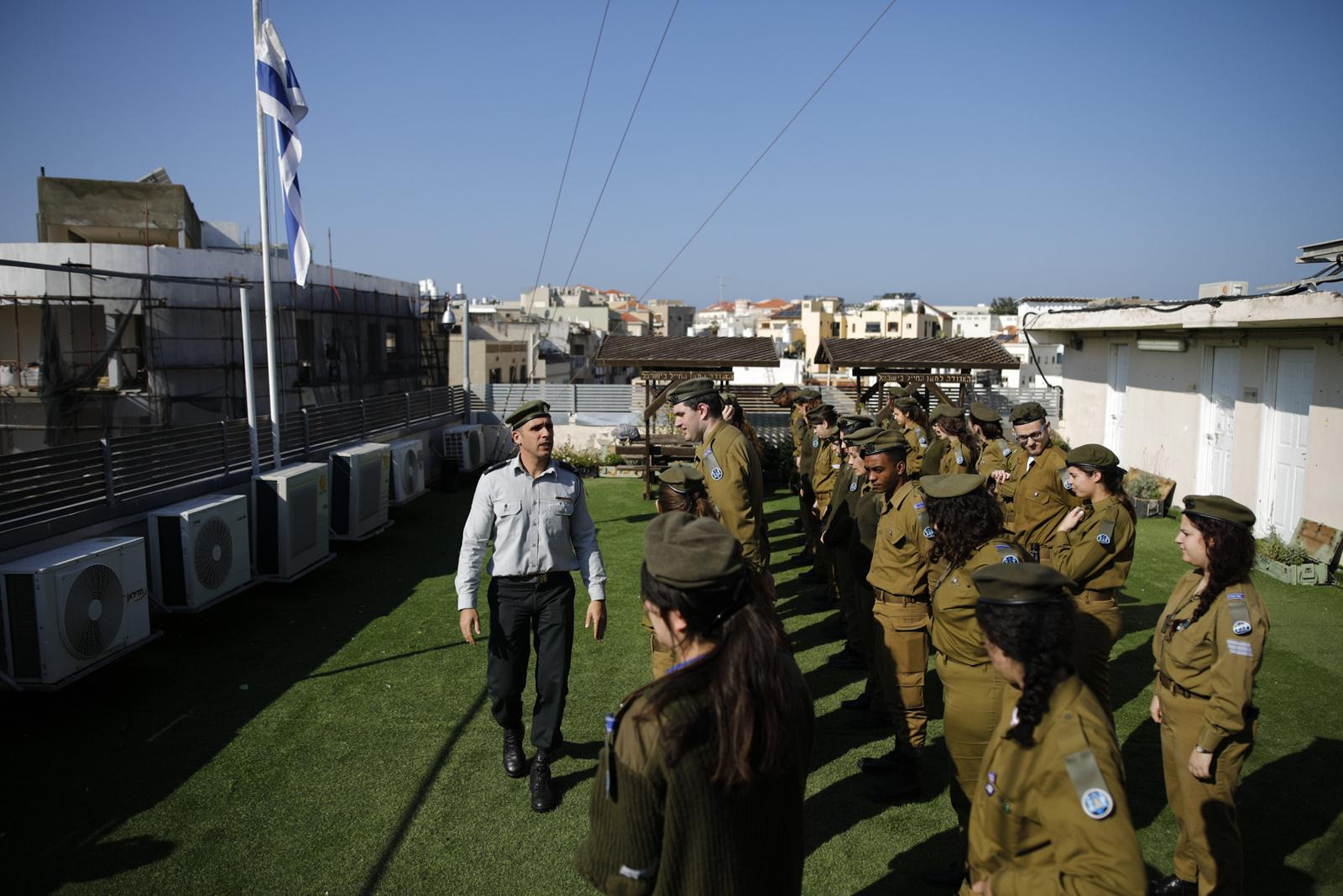 Soldiers prepare themselves to stand in order in front of the Master Seargant who is checking on their appearance and manner, on the rooftop of the IDF's Galgalatz radio station, January 07, 2018, in Tel Aviv, Israel. This routine takes place twice a week in a location decided by the Master Seargant, and occurs frequently on the station's rooftop.