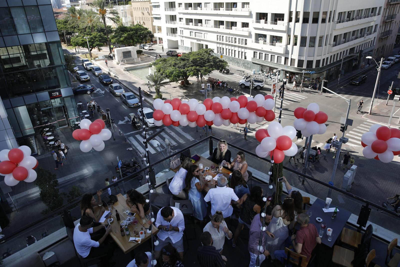 People celebrate a birthday party on the rooftop of the 'Speak Easy Bar', October 13, 2017, Tel Aviv, Israel.