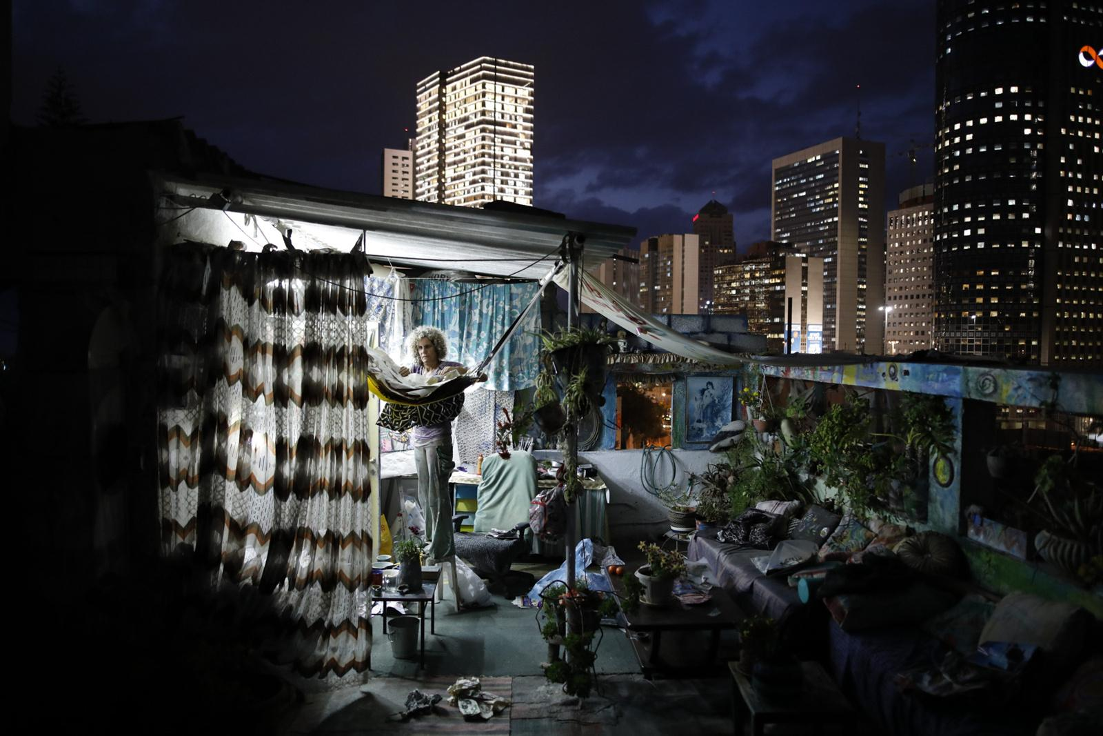 Ana Ashury, a mixed-media artist, stores away her artwork, on her rooftop in Ramat Gan, a suburb of Tel Aviv, November 19, 2017, Israel. She has been living in her place for the last 10 years and has recently begun to work on collages on her rooftop while she works as a video artist most of the time.