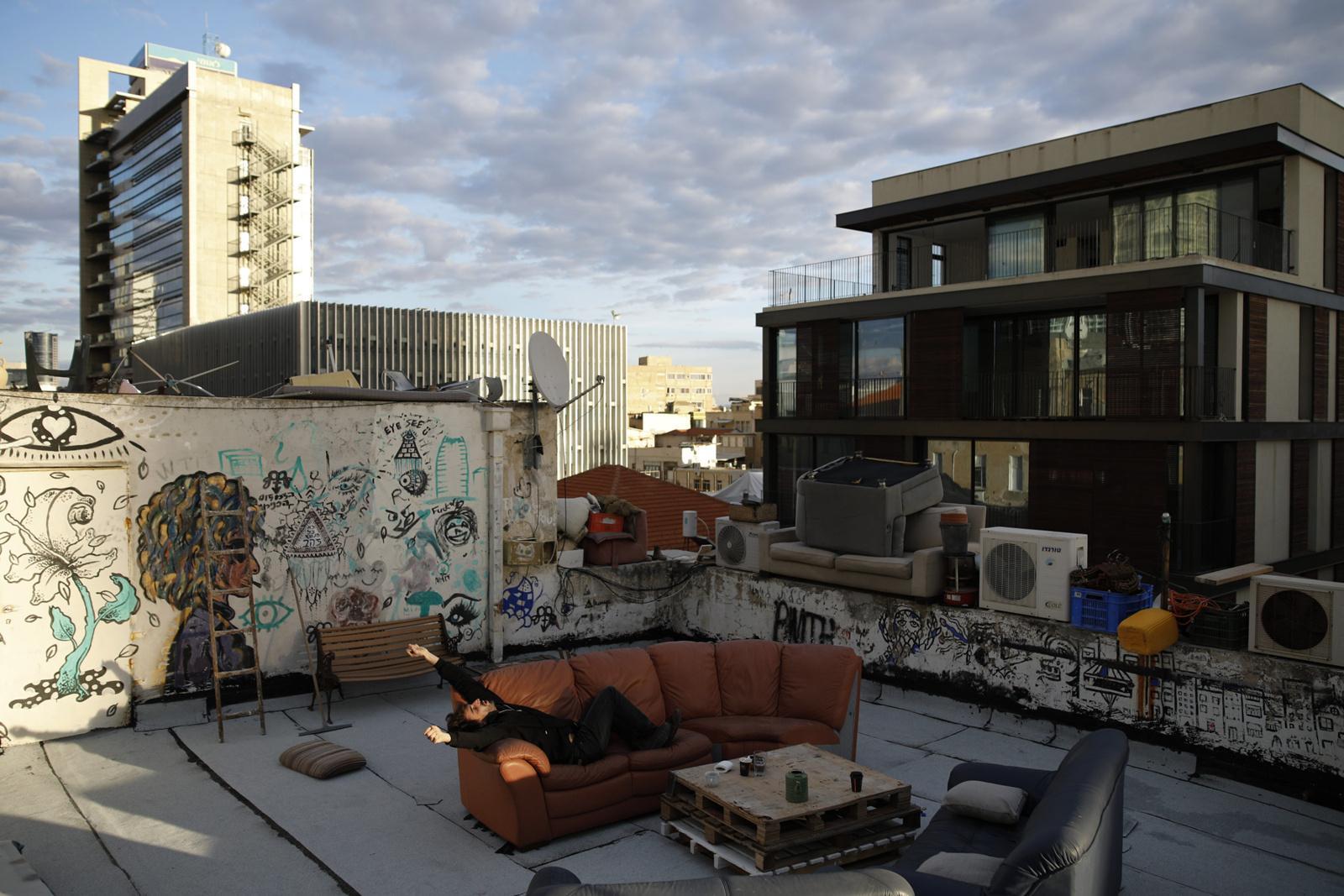 Guy Elhadad, 26, enjoys the afternoon sun on his rooftop, November 24, 2017, Tel Aviv, Israel.