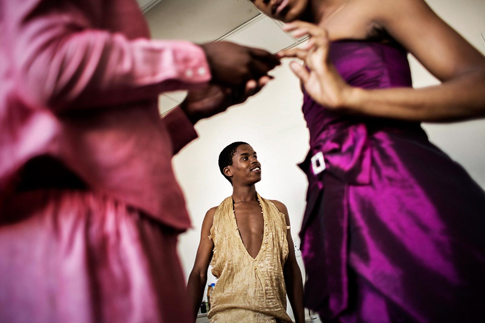 EAST LONDON, SOUTH AFRICA - SEPTEMBER 26, 2014: In preparation for the 'Miss Trans Diva' event on September 27, 2014 transgender woman Lazola Canzibe (C), 24, and some of her fellow contestants try on dresses at the office building of S.H.E. (Social, Health And Empowerment Feminist Collective Of Transgender And Intersex Women Of Africa) September 26, 2014 in East London, South Africa. Focusing on human rights 'Miss Trans Diva' is the second annual beauty pageant for trans women of East London and surrounding areas.