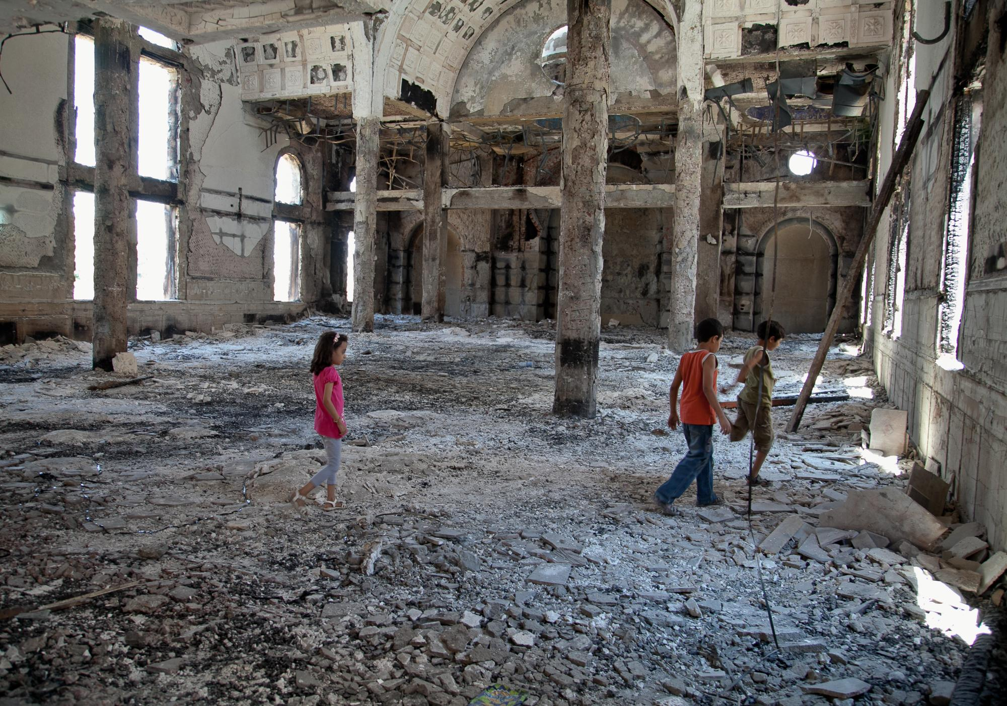 Children looking at the destruction at Al-Anba Mousa church in Minya that was attacked on August 14, 2013 by pro-Morsi supporters.