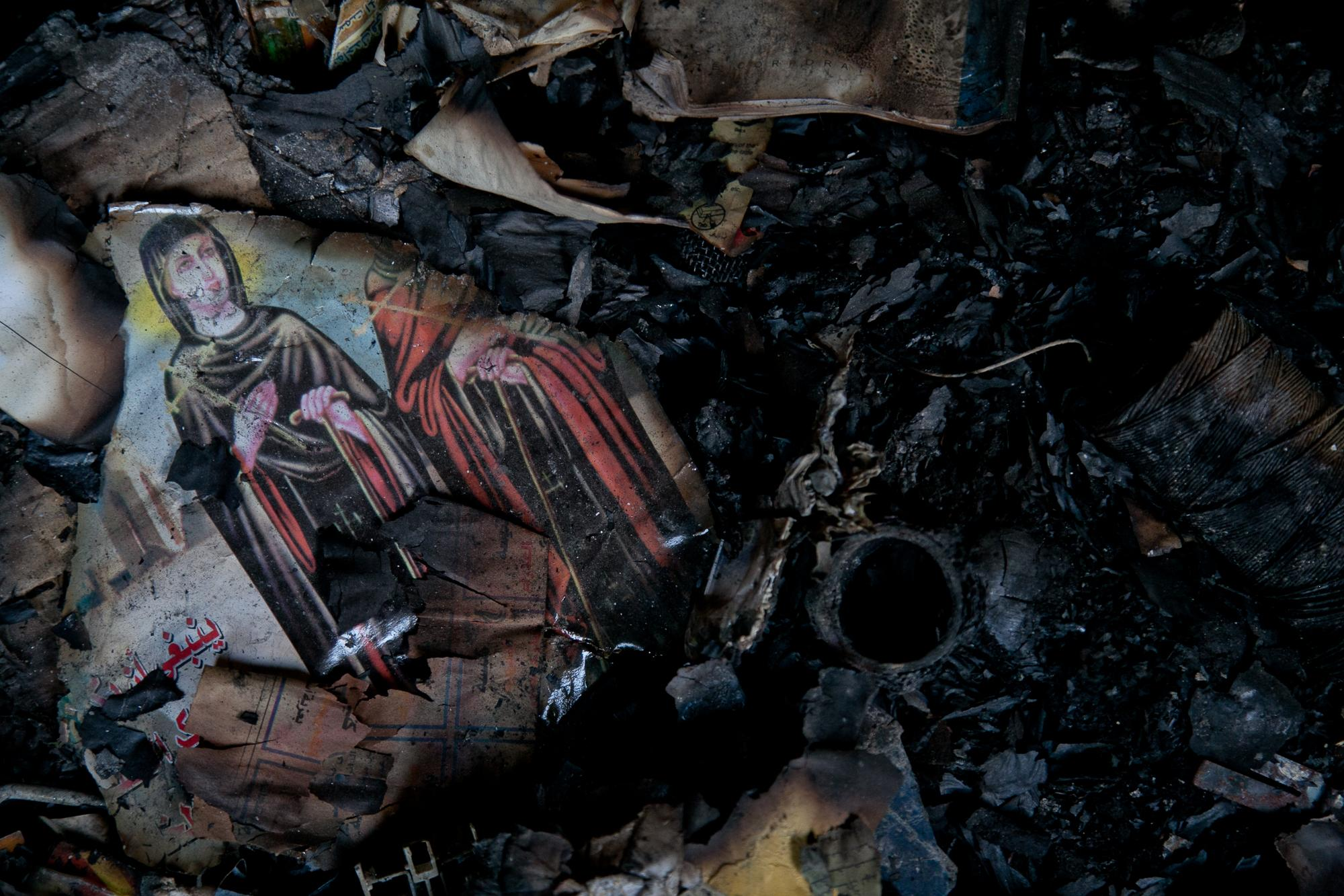Father Samuel Aziz Abdou's home in Minya was set on fire on August 14, 2013. It came under attack by a pro-Morsi mob. What is left of Father Abdou's library, burned books and religious pictures that are a constant reminder of that day.