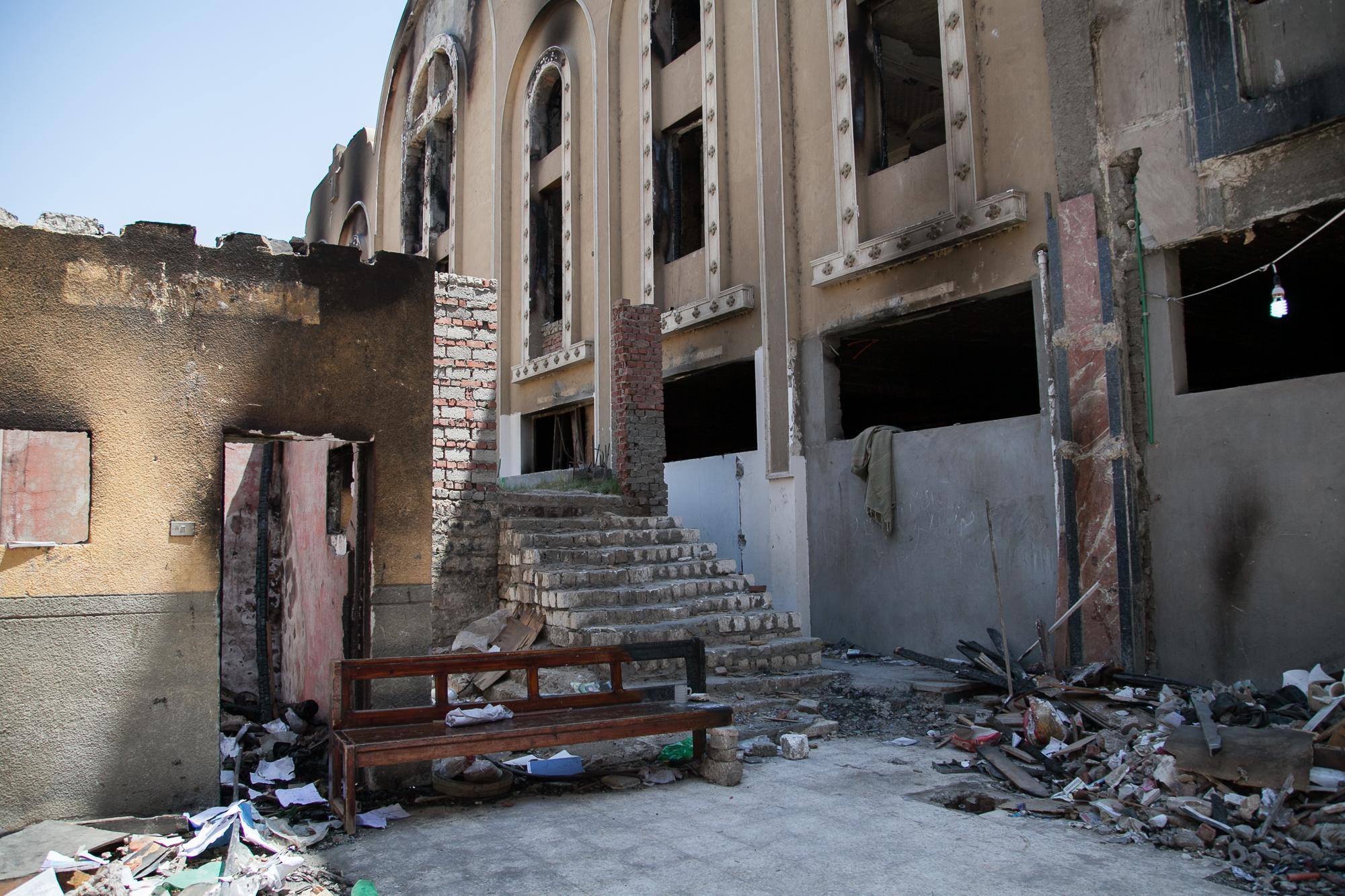 The outside of Al-Anba Mousa church in Minya. The church was attacked by groups of men on August 14, 2013, who were pro-Mohamed Morsi supporters. While Raba'a al Adawiya and Nahda (pro-Morsi sit-ins) were being cleared by security forces (where hundreds of people were killed) some pro-Morsi supporters attacked Coptic Christian churches, businesses and homes. Tension still remains quite high.