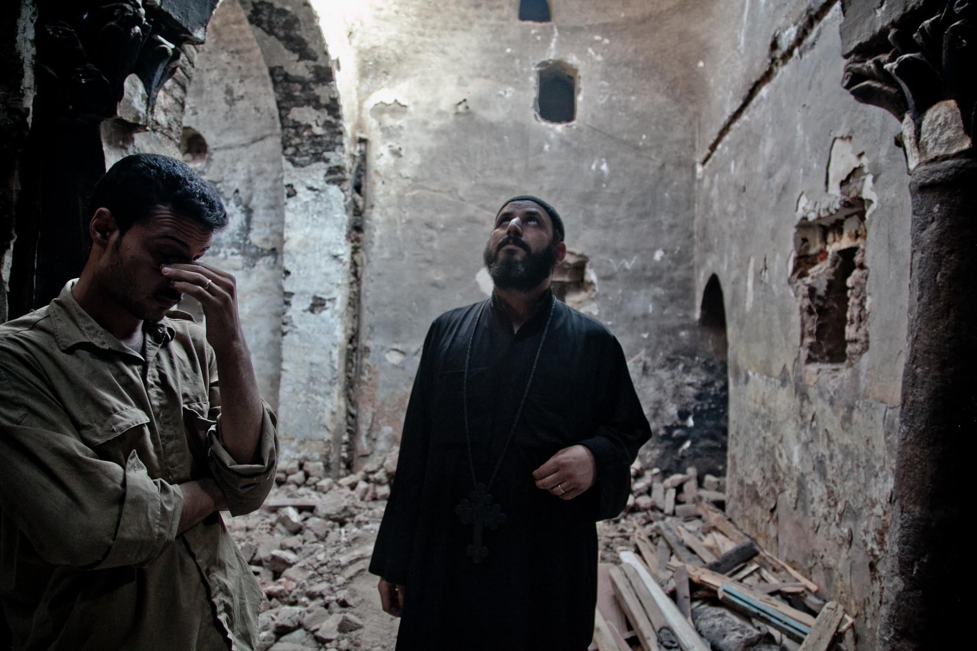 Pope Johannes stands in the middle of rubble in the underground Virgin Mary Church in Delga (which is over 1000 years old) the church was looted of ancient icons and the monastery burned for three days by groups of pro-Morsi supporters. The Muslim Brotherhood ran out the police in Delga so there is no police presence.