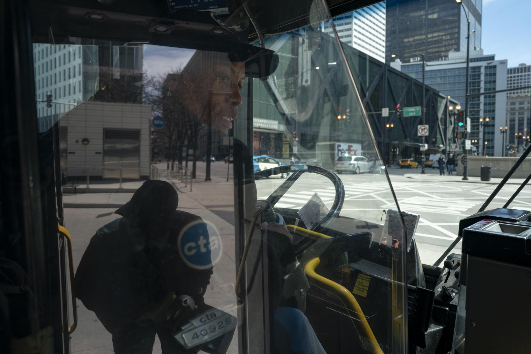 Bus driver Lorrie Lackland checks in with a Chicago Transit Authority agent before driving the 124 bus in Chicago on April 25, 2019. Lackland has been a bus driver for 14 years.