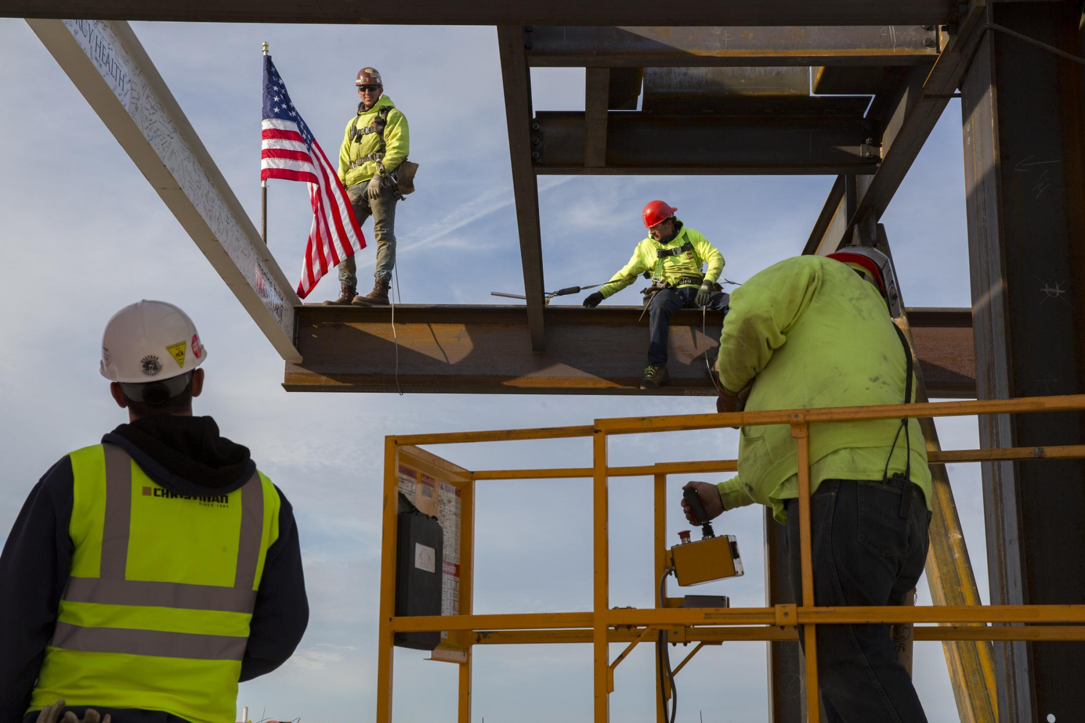 Crew members put the last structural beam into place at the construction site of the 10-story Mercy Health medical center in Muskegon, Michigan on Oct. 26, 2017.