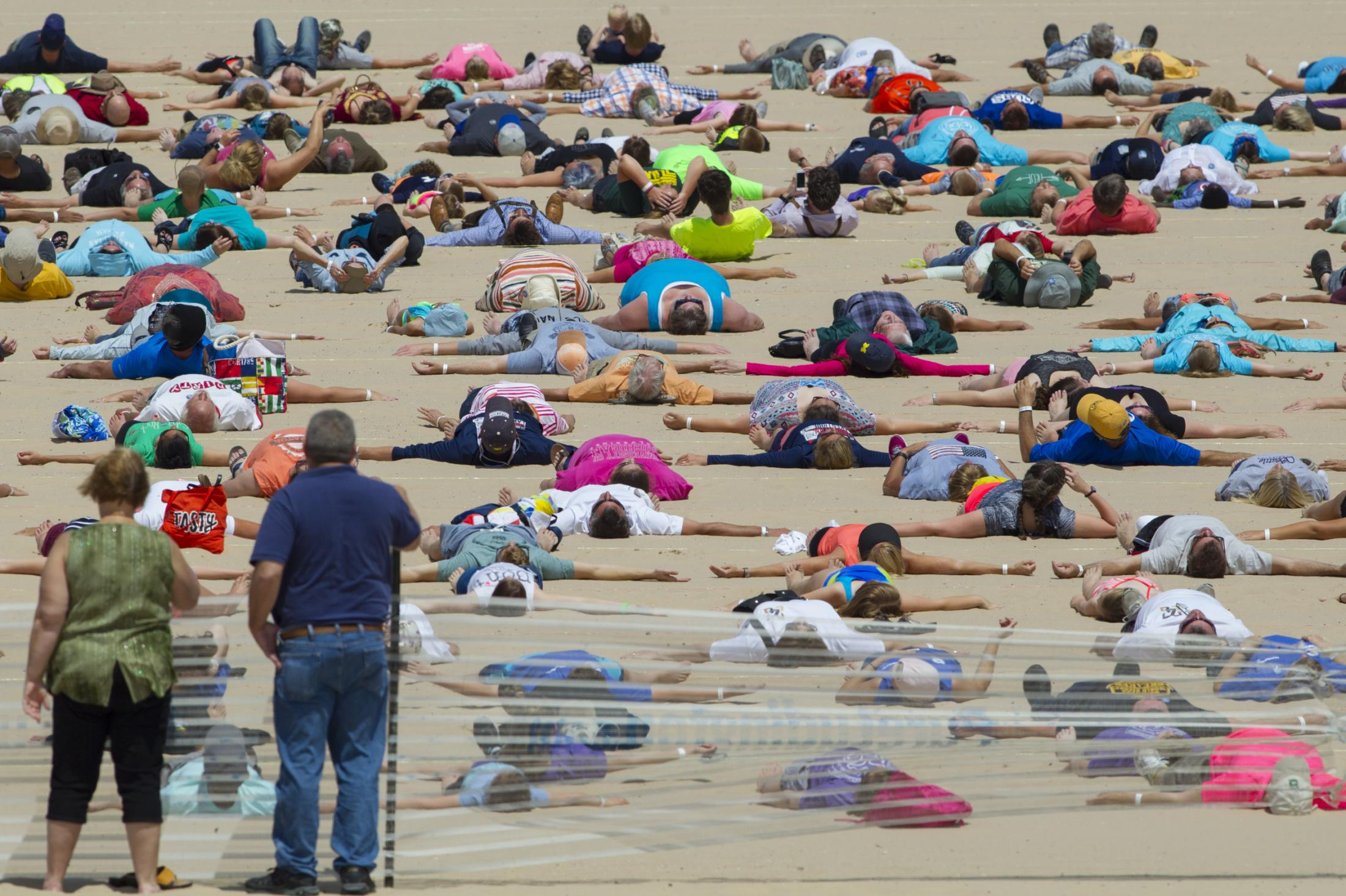 "1,414 people participate in the Guinness World Record attempt for ""Most Sand Angels Made Simultaneously"" at the beach in Ludington, Michigan on June 10, 2017. Ludington officially broke the record with 1,387 people, 27 people were disqualified for various reasons."
