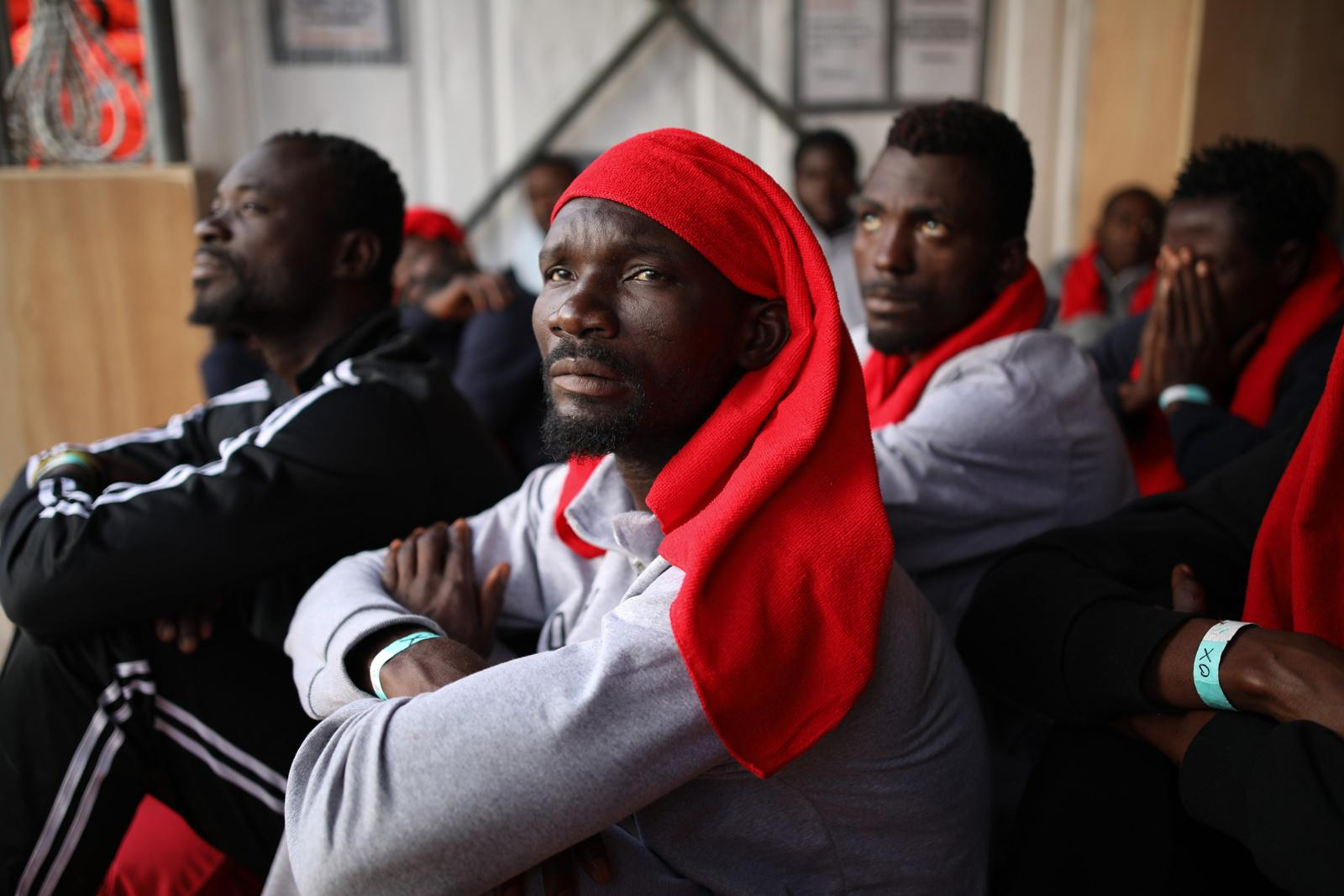 Ghanaian refugee Dramani Ahmed (center), 30, and fellow refugees from Ghana and Nigeria wait for their disembarkation from the rescue vessel 'VOS Hestia' at the port of Trapani, Italy, two days after they have been rescued from a dinghy, crossing the Mediterranean from Libya to Italy, June 05, 2017. The sea journey took the life of Ahmed's friend Zibo, among four casualties in total. The Central Mediterranean route is the world's deadliest migration route. Of the estimated 3,080 people that have died or gone missing while trying to reach Europe by sea via the three Mediterranean routes until end of November 2017, over 94% of deaths have occurred from North Africa to Italy, according to UNHCR. Over 117,000 refugees and migrants arrived in Italy by sea in 2017, about 32% less compared to 2016.