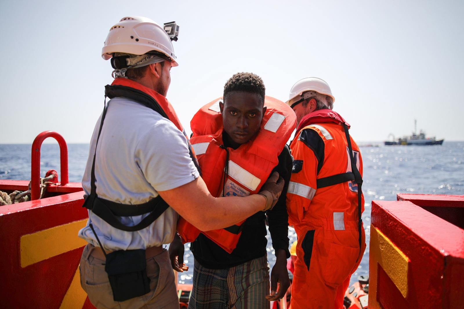 A refugee is taken on deck of the rescue vessel 'VOS Hestia', shortly after having been rescued from a dinghy on the Mediterranean sea off the Libyan coast, June 03, 2017. Severe burns stretch over the body of one refugee (left), due to a dangerous mixture of salt water and leaking fuel accumulating in the bottom of the small and overcrowded dinghies. The sea journey took the lives of four migrants. The Central Mediterranean route is the world's deadliest migration route. Of the estimated 3,080 people that have died or gone missing while trying to reach Europe by sea via the three Mediterranean routes until end of November 2017, over 94% of deaths have occurred from North Africa to Italy, according to UNHCR. Over 117,000 refugees and migrants arrived in Italy by sea in 2017, about 32% less compared to 2016.