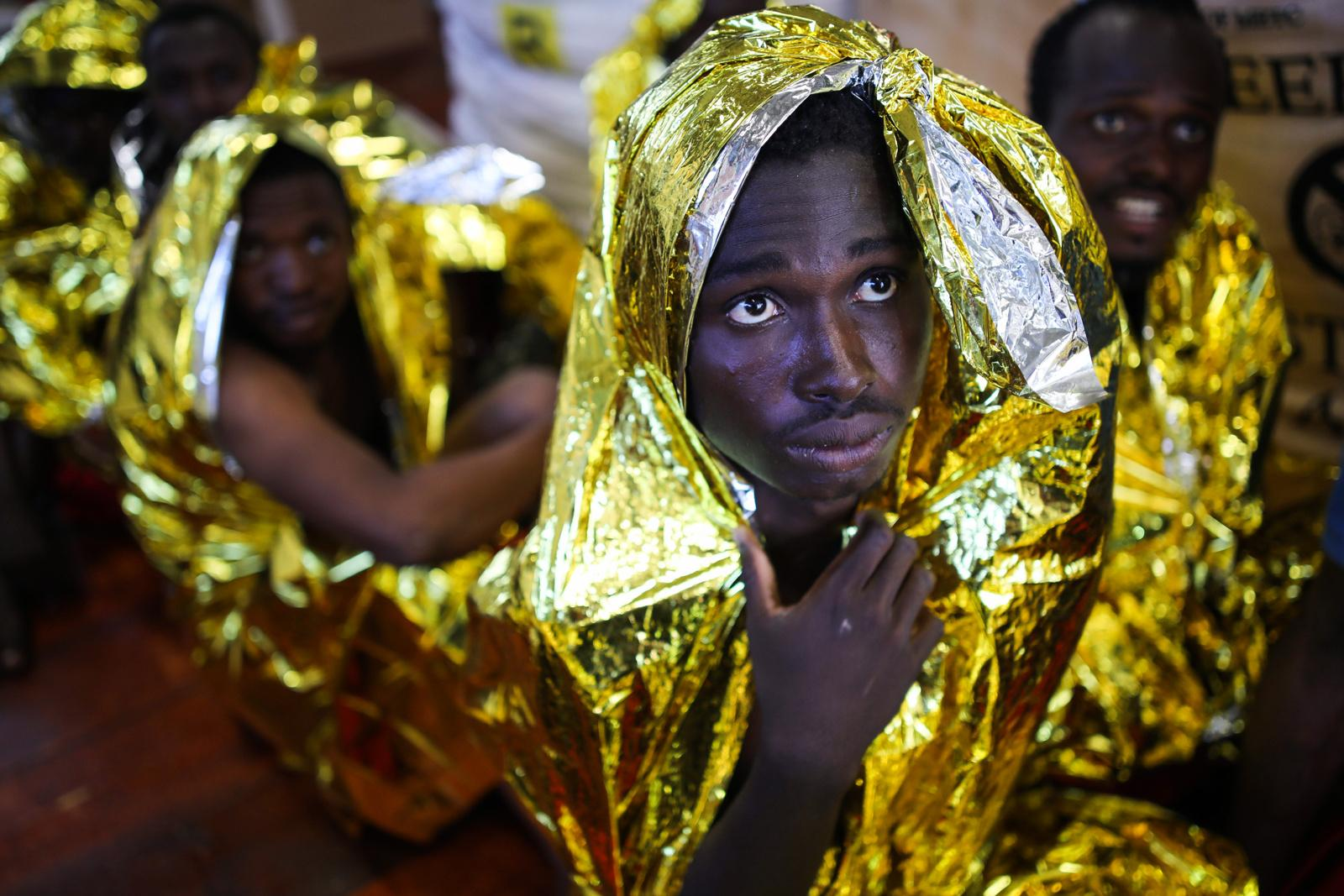 Nigerian Refugees wrap themselves in survival foil to keep warm on deck of the rescue vessel 'VOS Hestia', shortly after they have been rescued from a dinghy on the Mediterranean sea off the Libyan coast, June 03, 2017. The sea journey took the lives of four migrants. The Central Mediterranean route is the world's deadliest migration route. Of the estimated 3,080 people that have died or gone missing while trying to reach Europe by sea via the three Mediterranean routes until end of November 2017, over 94% of deaths have occurred from North Africa to Italy, according to UNHCR. Over 117,000 refugees and migrants arrived in Italy by sea in 2017, about 32% less compared to 2016.