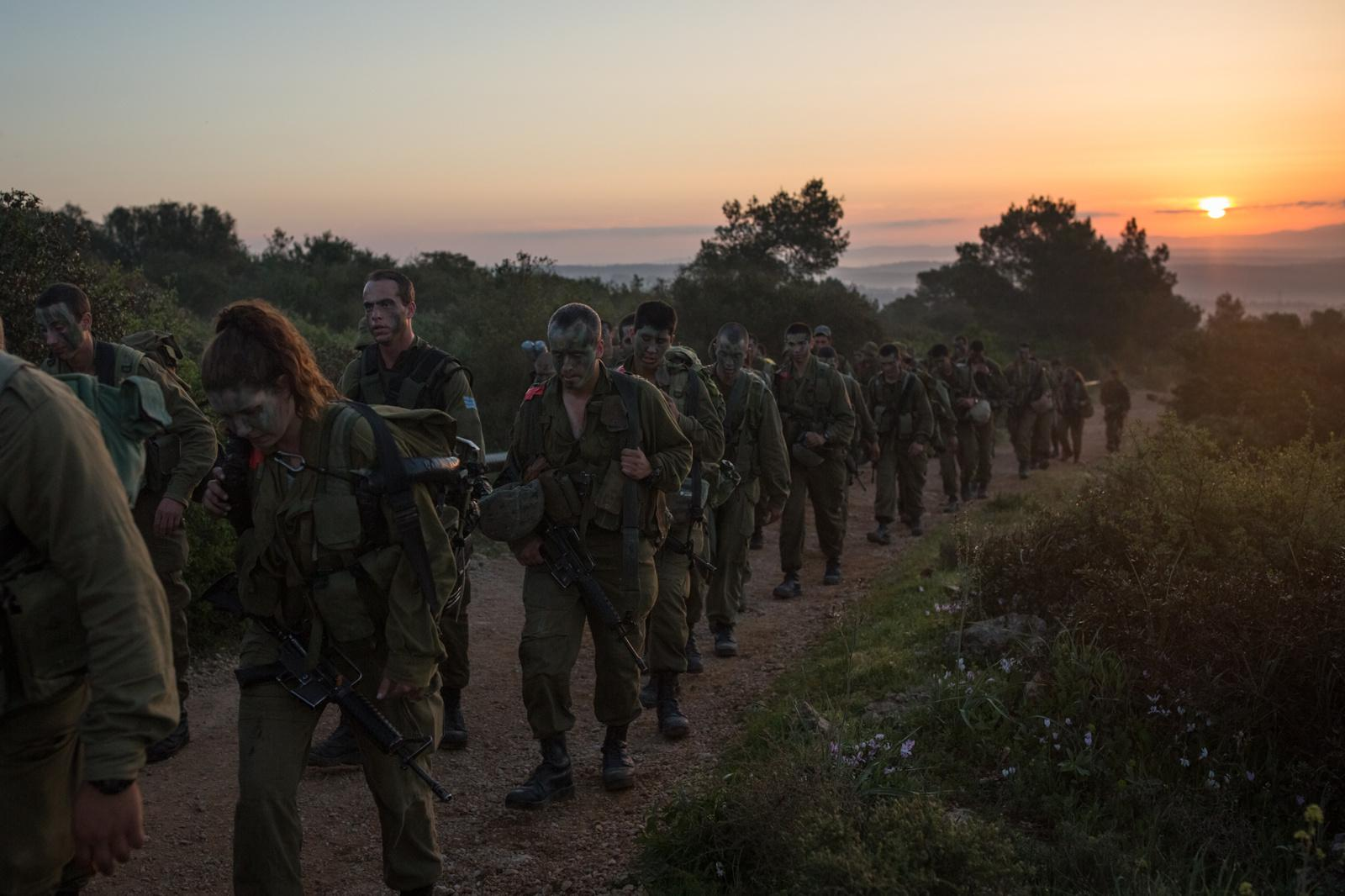 BINYAMINA, ISRAEL - MARCH 08, 2017: Soldiers from the Artillery Corps take part in a baret march at the end of their basic army training on March 08, 2017, near the Northern town of Binyamina, Israel. Around 600 soldiers participated in the march of around 25km, that lasted from midnight until the early morning hours.