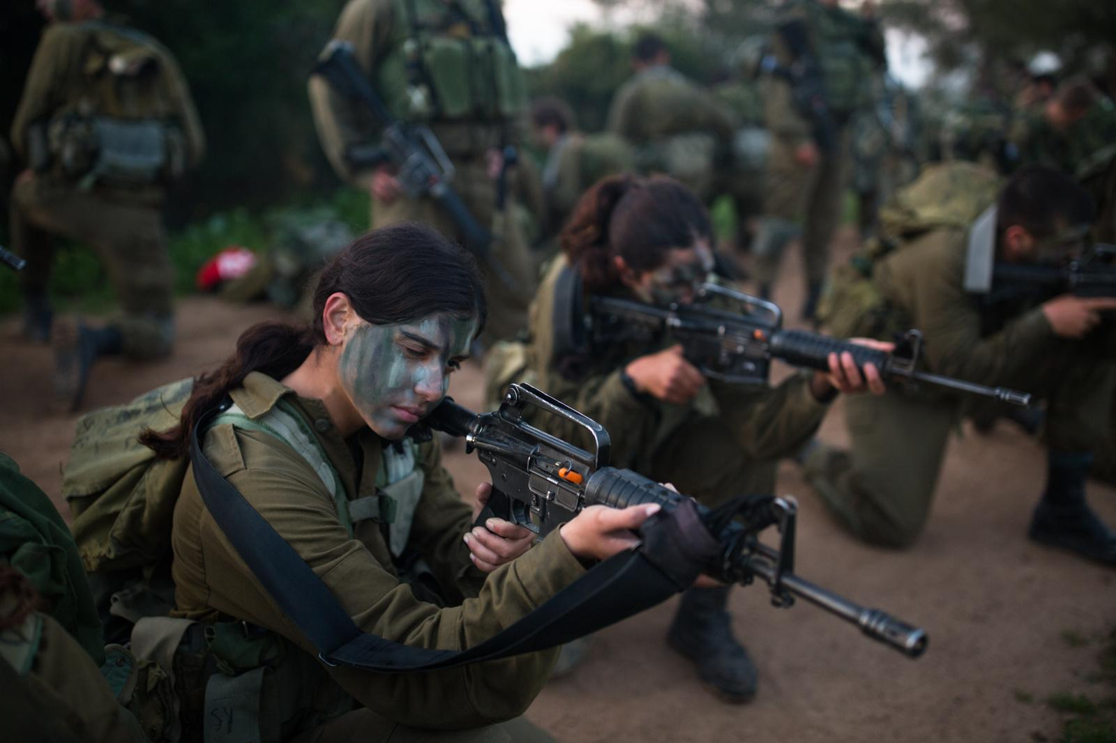 BINYAMINA, ISRAEL - MARCH 08, 2017: Soldiers from the Artillery Corps line up holding their rifles during a baret march at the end of their basic army training on March 08, 2017, near the Northern town of Binyamina, Israel. Around 600 soldiers participated in the march of around 25km, that lasted from midnight until the early morning hours.