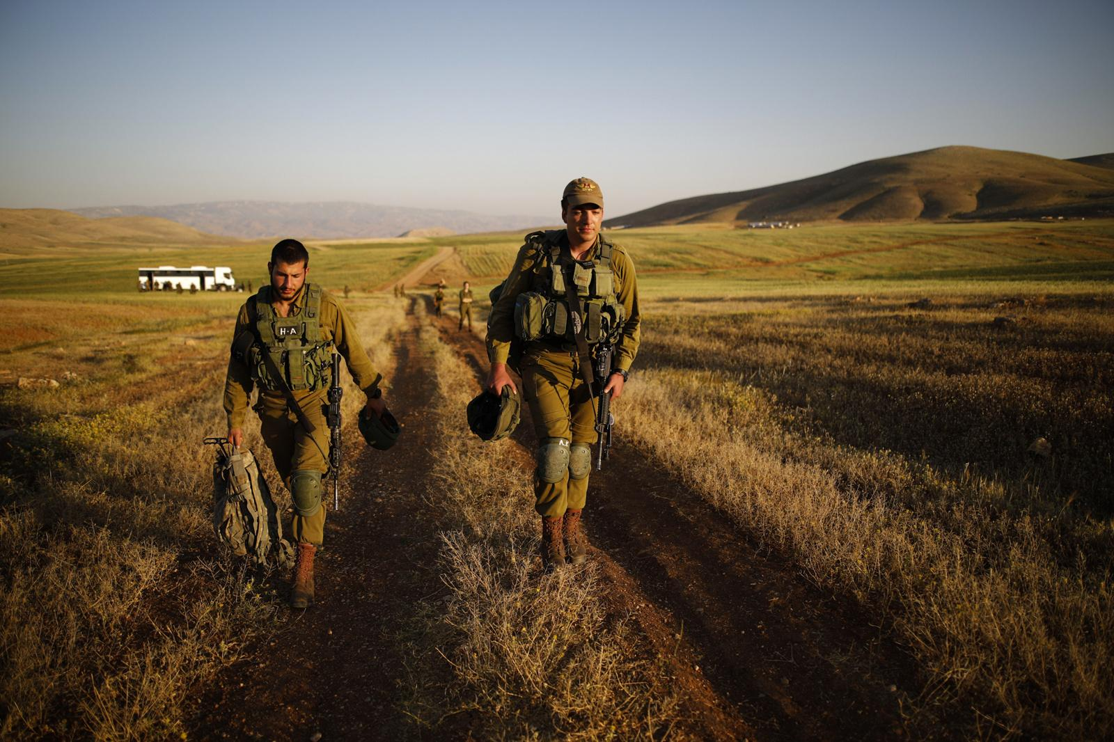 JORDAN VALLEY, ISRAEL - APRIL 05, 2017: Israeli infantry soldiers from the Haruv battalion of the Kfir Brigade are on their way to a counterterrorism drill that takes place in open fields close to the Kfir Brigade base in the Jordan Valley, West Bank, Israel, on April 05, 2017.