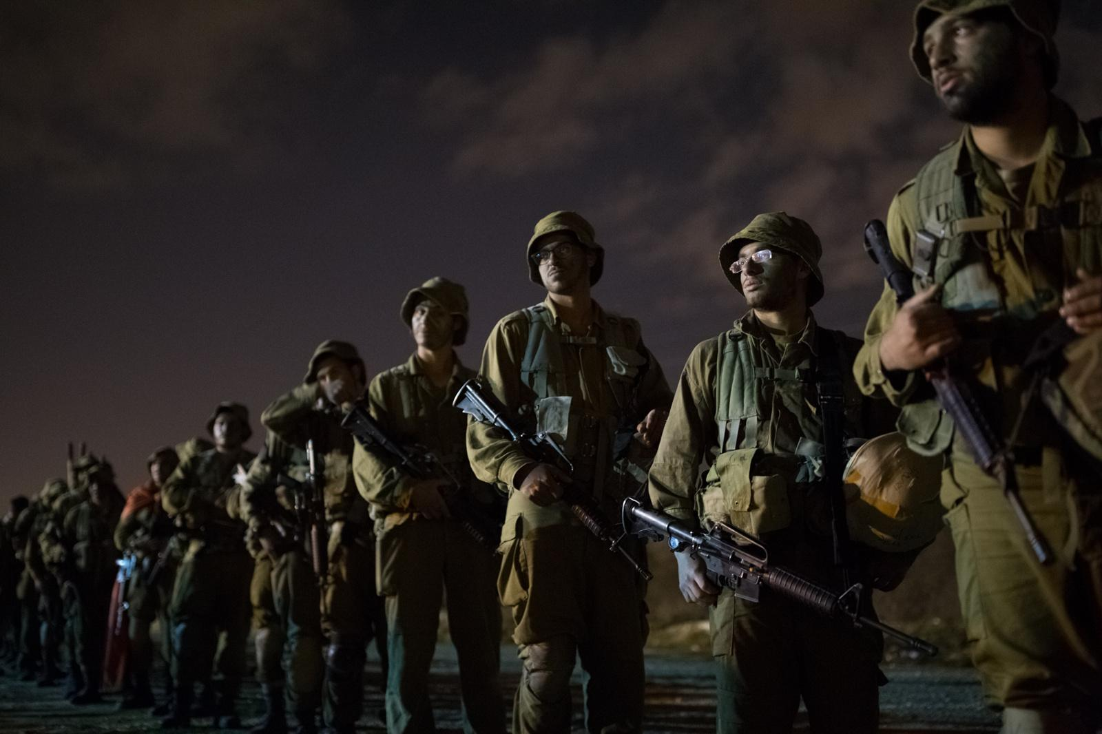 BINYAMINA, ISRAEL - MARCH 08, 2017: Soldiers from the Artillery Corps listen to their commander before taking part in a baret march at the end of their basic army training on March 08, 2017, near the Northern town of Binyamina, Israel. Around 600 soldiers participated in the march of around 25km, that lasted from midnight until the early morning hours.