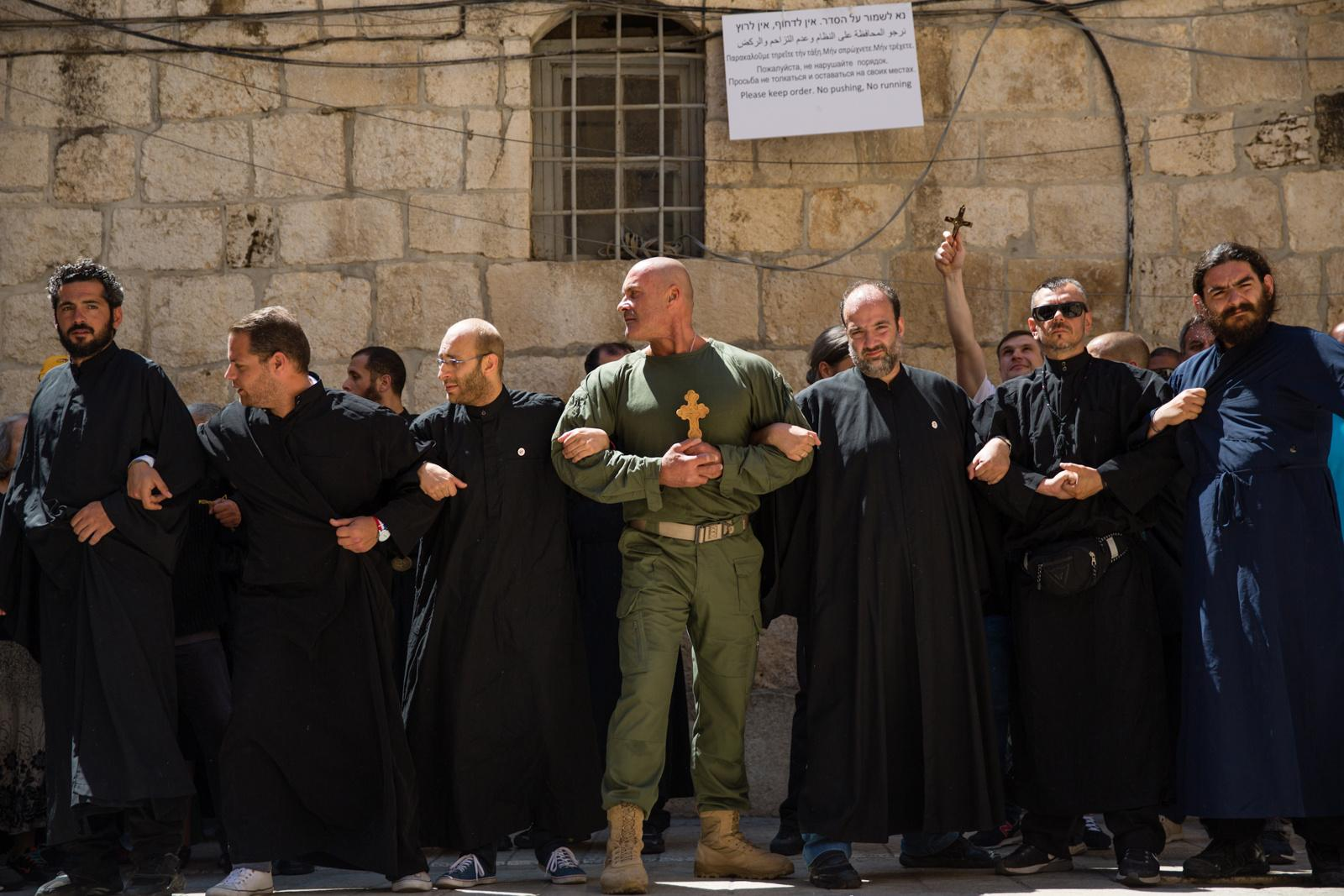 JERUSALEM, ISRAEL - APRIL 29, 2016: Christian worshippers take part in a Good Friday procession on the Via Dolorsa in Jerusalem's Old City on April 29, 2016. Via Dolorosa is held to be the path that Jesus walked on the way to his crucifixion. It is marked by nine of the fourteen Stations of the Cross. The last five stations are inside the Church of the Holy Sepulchre.