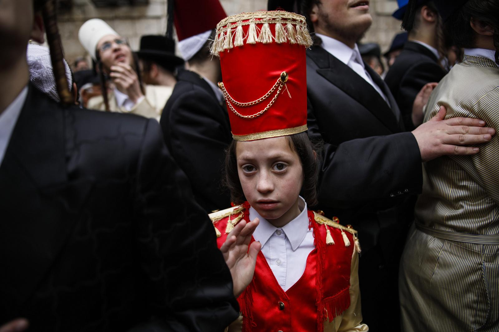 Ultra-Orthodox Jews wearing costumes celebrate the Jewish holiday of Purim in the ultra-Orthodox neighborhood of Mea Shearim in Jerusalem, Israel, March 13, 2017. The Jewish holiday of Purim celebrates the Jews' salvation from genocide in ancient Persia, as recounted in the Book of Esther.