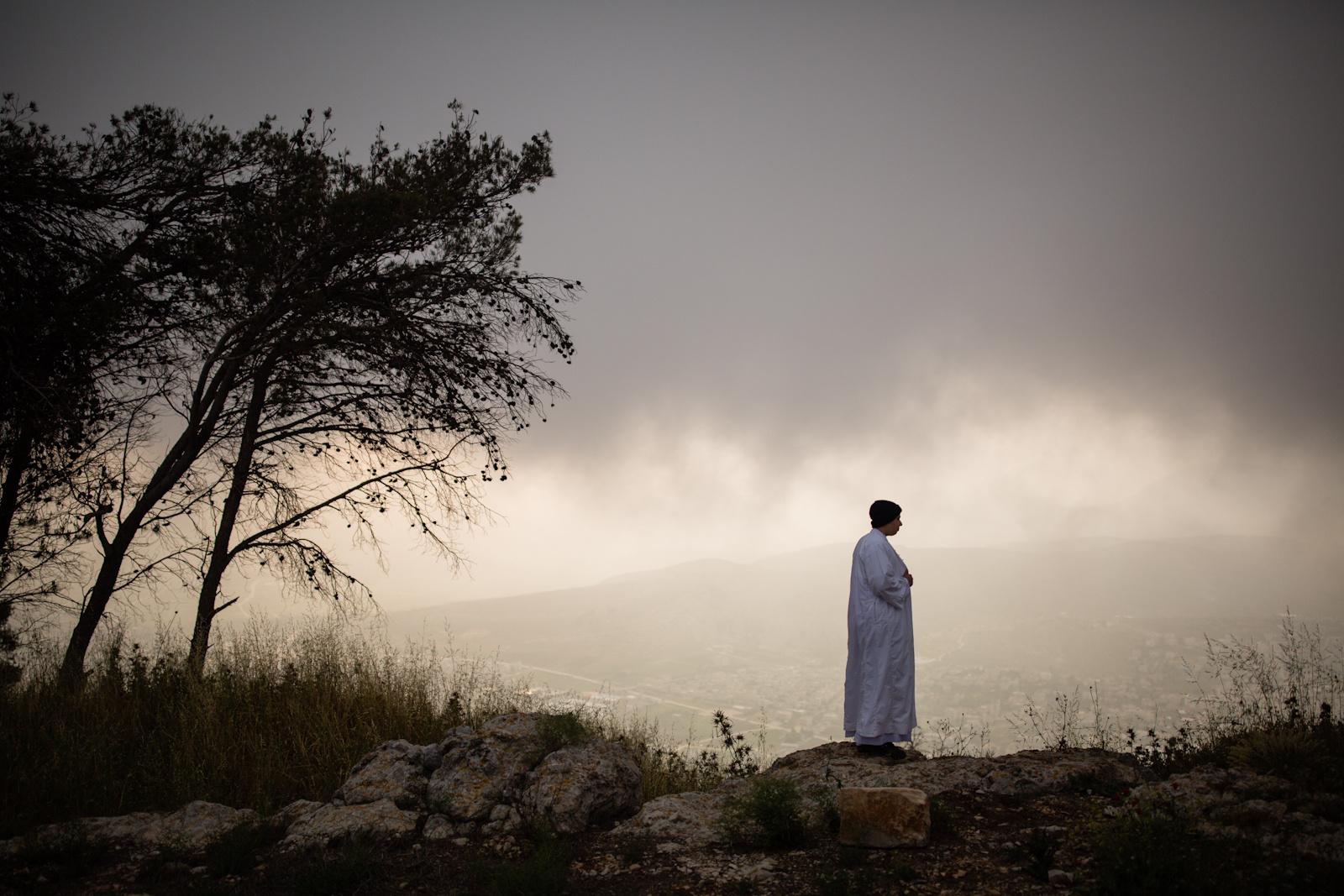 NABLUS, PALESTINIAN TERRITORIES - APRIL 27, 2016: Samaritans take part in a pilgrimage marking the holiday of Passover at Mount Gerizim on the outskirts of the West City of Nablus April 27, 2016. The Samaritans, who trace their roots to the Biblical kingdom of Israel in what is now the northern occupied West Bank, observe religious practices similar to those of Judaism.