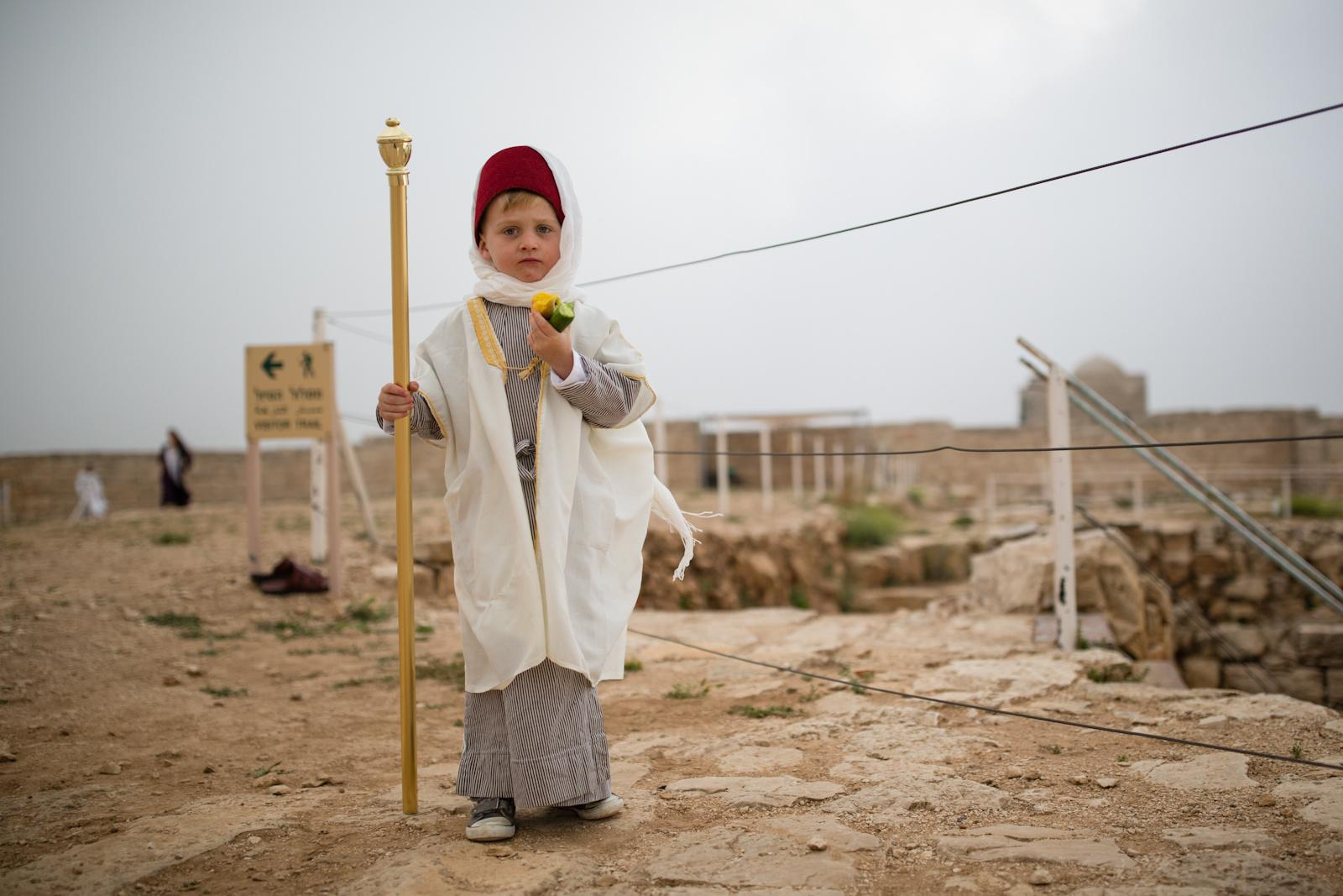 NABLUS, PALESTINIAN TERRITORIES - APRIL 27, 2016: A Samaritan boy takes part in a pilgrimage marking the holiday of Passover at Mount Gerizim on the outskirts of the West City of Nablus April 27, 2016. The Samaritan religion is descended from the ancient Israelite tribes of Menashe and Efraim, and the community numbers today around 700 people, half at Mount Grizim in the West Bank and the others in Holon near Tel Aviv in Israel.