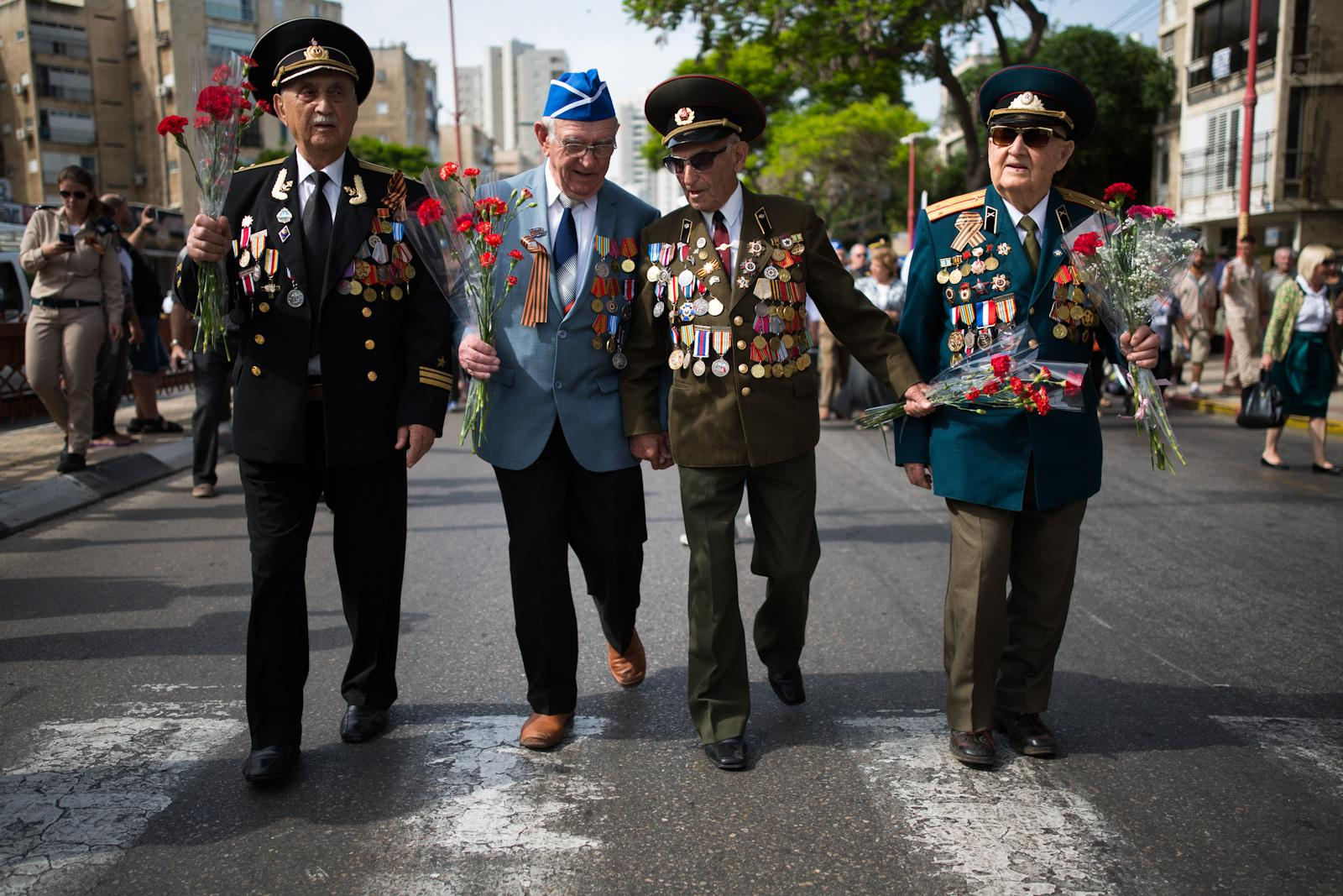 ASHDOD, ISRAEL - MAY 09, 2016: Russian-Israeli World War II veterans take part in the Veterans Day parade in honor of 71 years since the Allies' victory over Nazi Germany in World War II, in Ashdod, May 09, 2016.