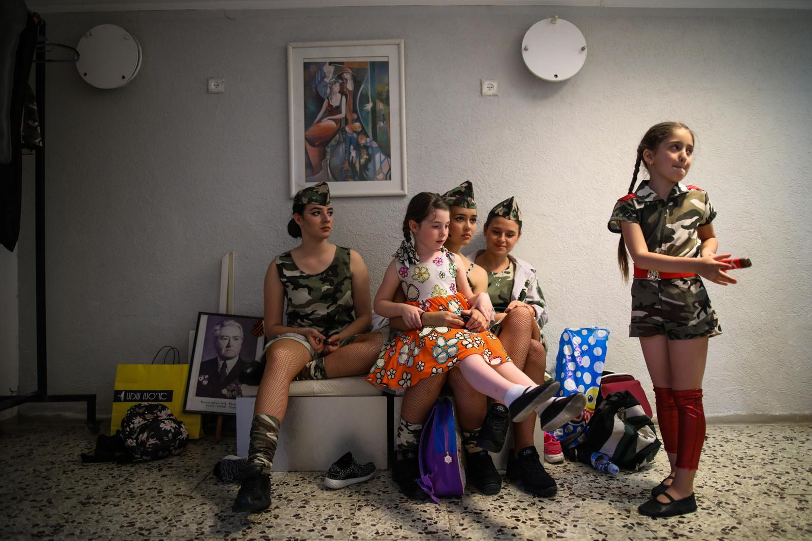 Young women prepare backstage for a performance during an event in remembrance of Victory Day, marking the anniversary of the Allied victory over Nazi Germany, in the southern city of Ashdod, Israel May 9, 2017.