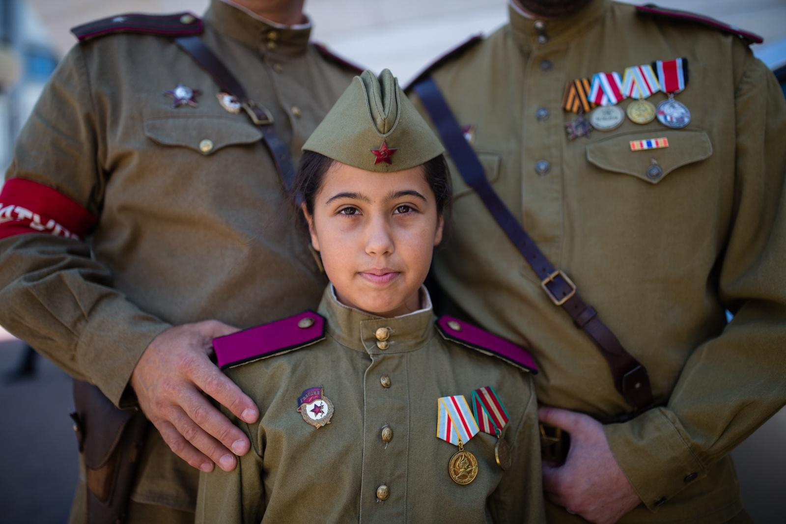 ASHDOD, ISRAEL - MAY 07, 2016: A girl wearing a Red Army uniform poses for a portrait during an event in remembrance of the upcoming Victory Day, marking the anniversary of the Allied victory over Nazi Germany, in the southern city of Ashdod, May 7, 2016.