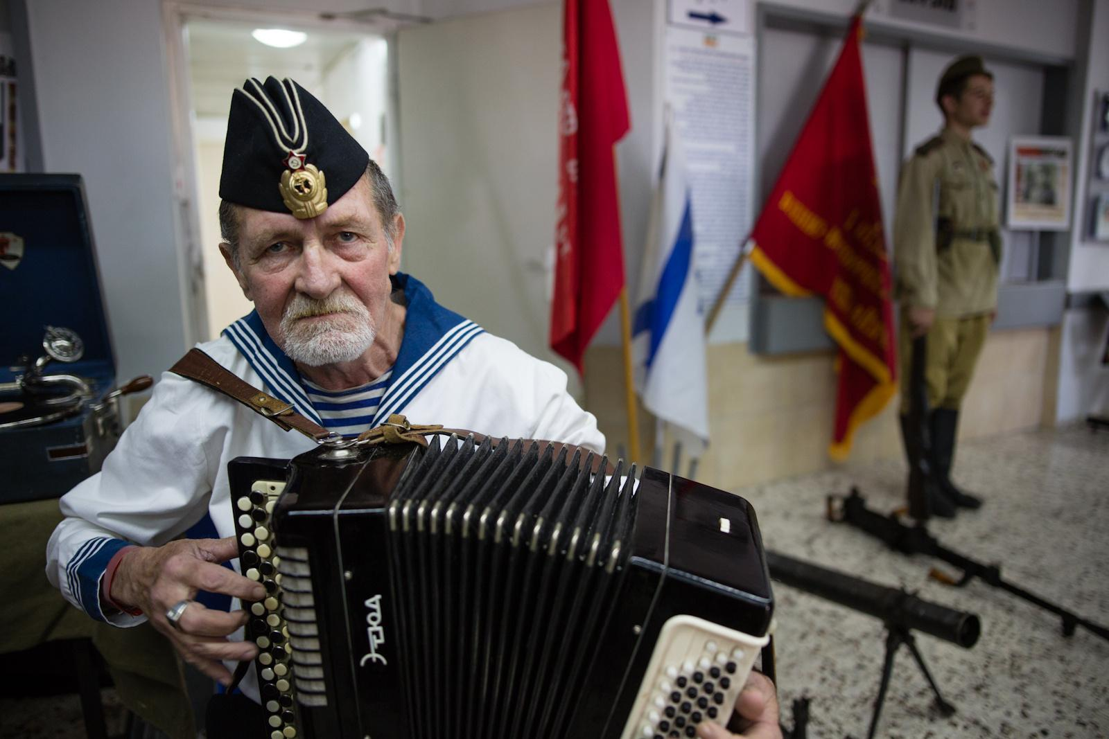 ASHDOD, ISRAEL - MAY 07, 2016: A man plays the accordion during an event in remembrance of the upcoming Victory Day, marking the anniversary of the Allied victory over Nazi Germany, in the southern city of Ashdod, May 7, 2016.