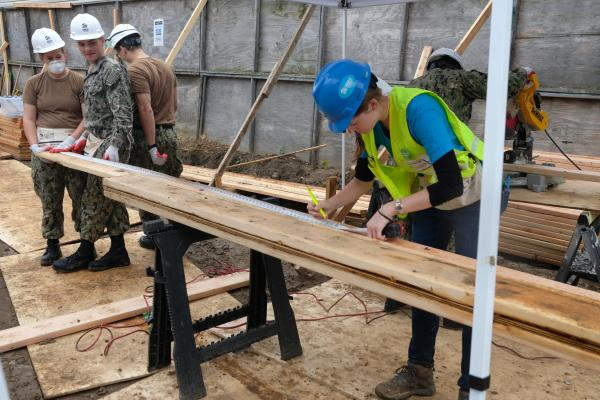 Navy sailors work on Habitat for Humanity project during Fleet Week. South Ozone Park, Queens