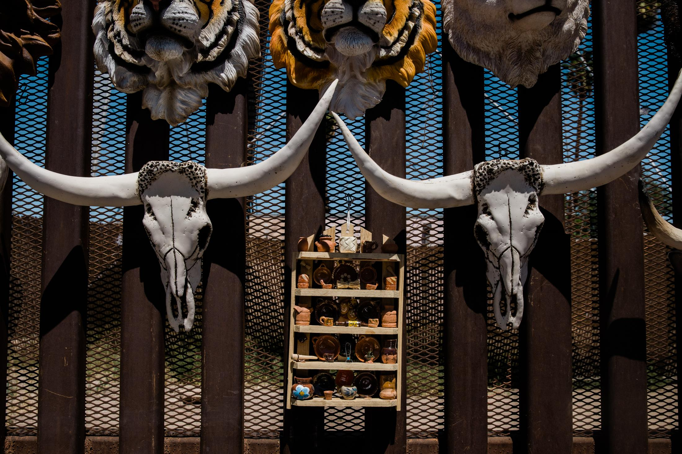 Souvenirs are displayed on the border fence the divides the US and Mexico in Mexicali on April 4, 2019.