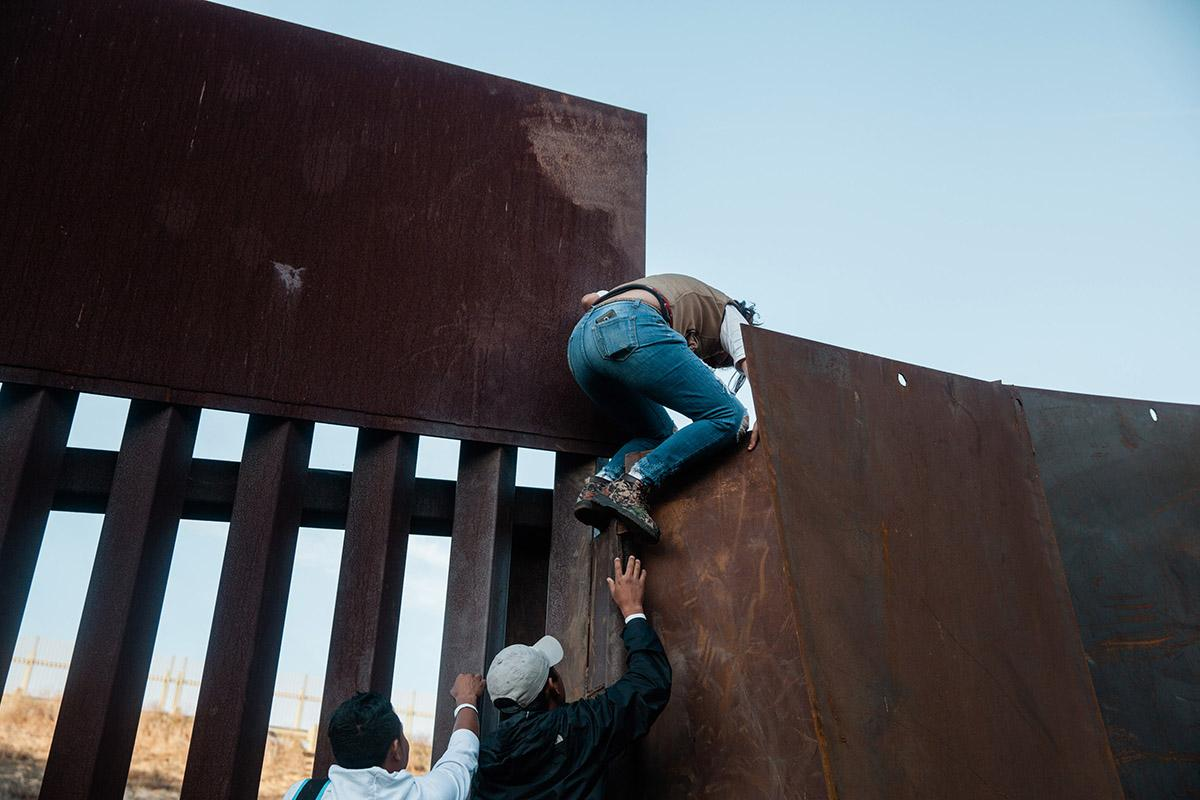 With growing frustration at the length of the asylum process, a dozen migrants decide to jump the border fence that divides the United States and Mexico on December 2, 2018 near Las Playas de Tijuana, Mexico.