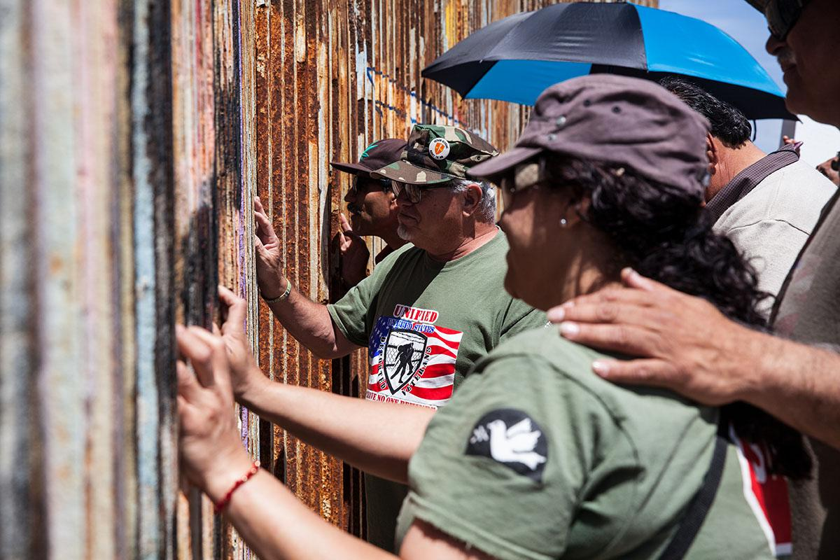 Veterans at the border fence in Playas de Tijuana, Mexico to visit loved ones that are in the United States. In the U.S. there is only a four hour window every Saturday and Sunday to visit but on the Mexico side they do not have time restrictions.