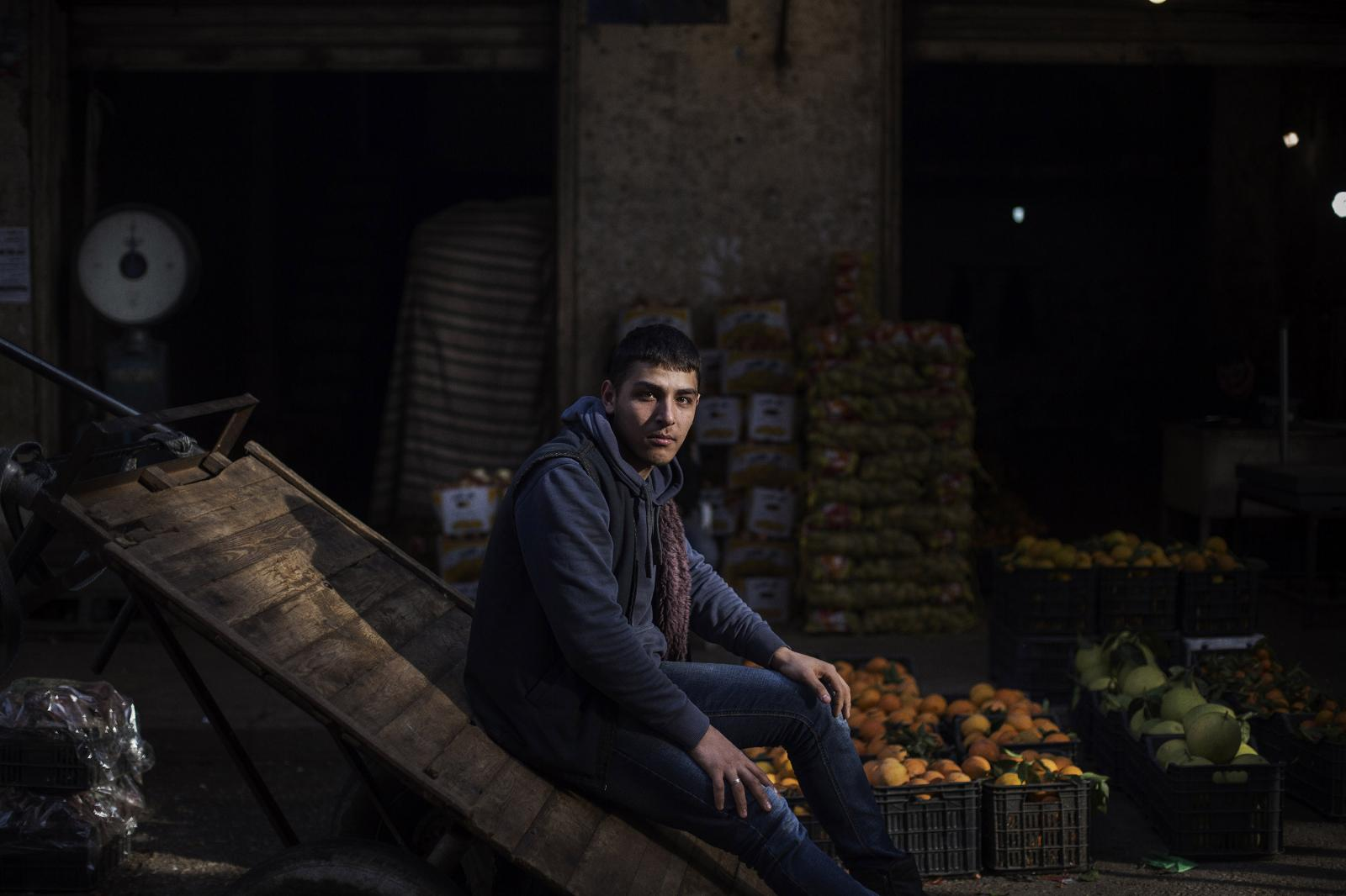 """Radwan Rashid, 19 years old from Idlib, Syria. Dropped out of school three years ago and does odd jobs at the souk. """"We fled to here and now we want to flee from here."""" Bab al-Tabbaneh, Tripoli. Lebanon. December 11th, 2019. Diego Ibarra Sánchez for CNN"""